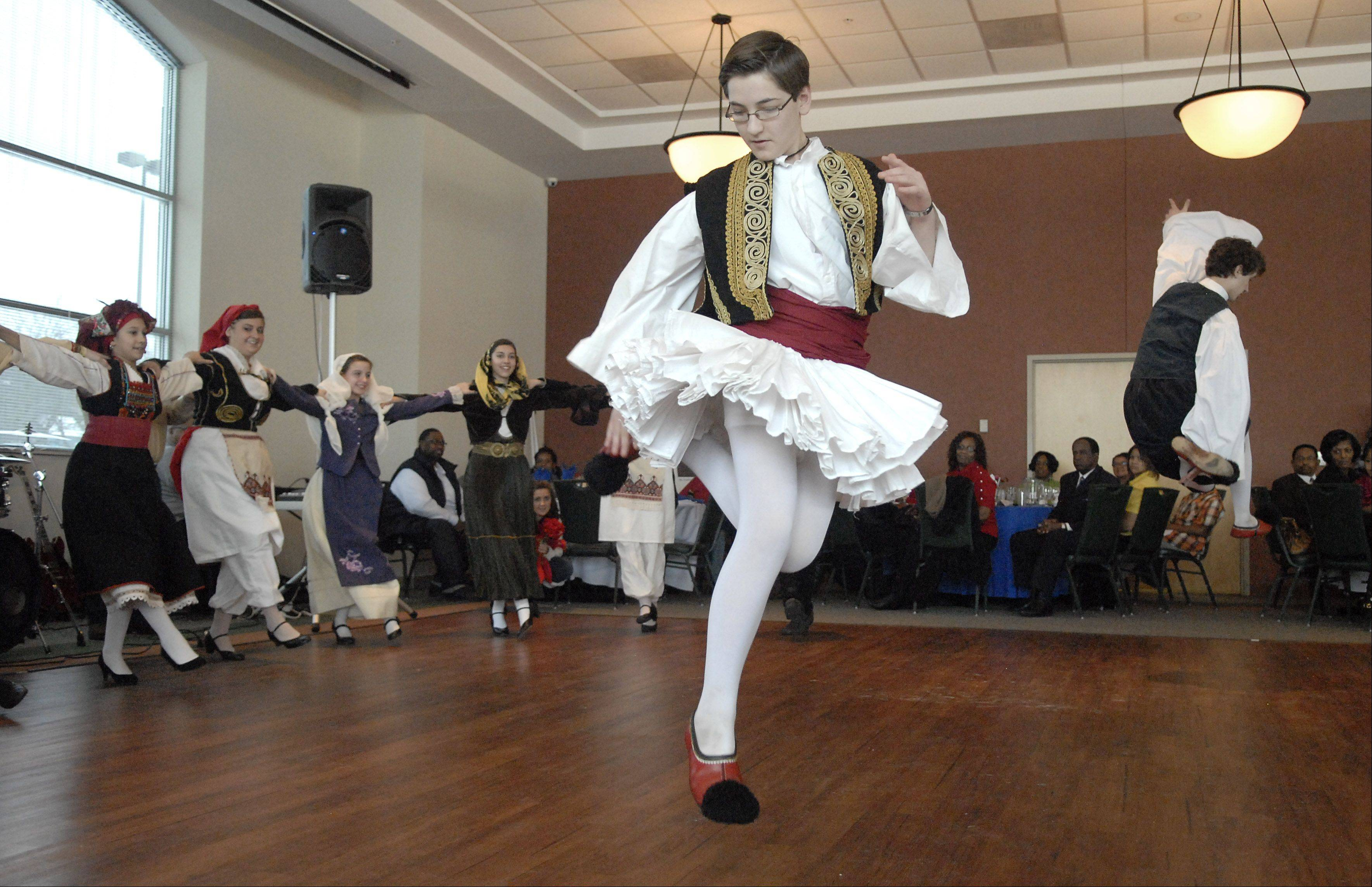Alexander Bravos, 14, of St. Charles, left, and his brother, Thomas, 16, perform with The Agape Dance Troops at the 27th annual Dr. Martin Luther King, Jr., Prayer Breakfast in Elgin. The group, from St. Sophia Greek Orthodox Church in Elgin, was invited to perform at the event.