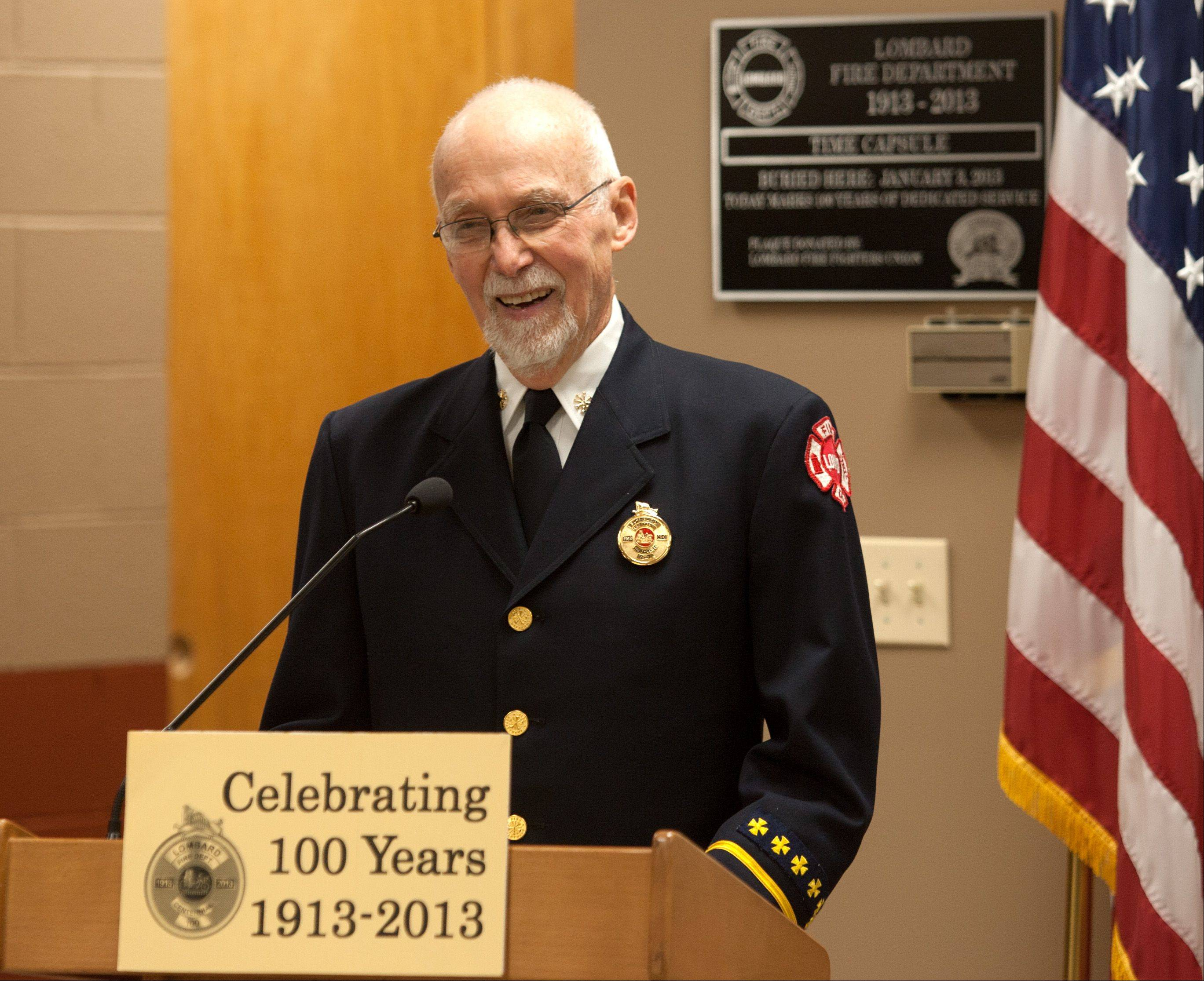 Former Lombard Fire Chief Jack Jones, who served from 1963-79, discusses the department's history during a ceremony honoring the Lombard Fire Department's 100th anniversary. The department held its first meeting Jan. 3, 1913.