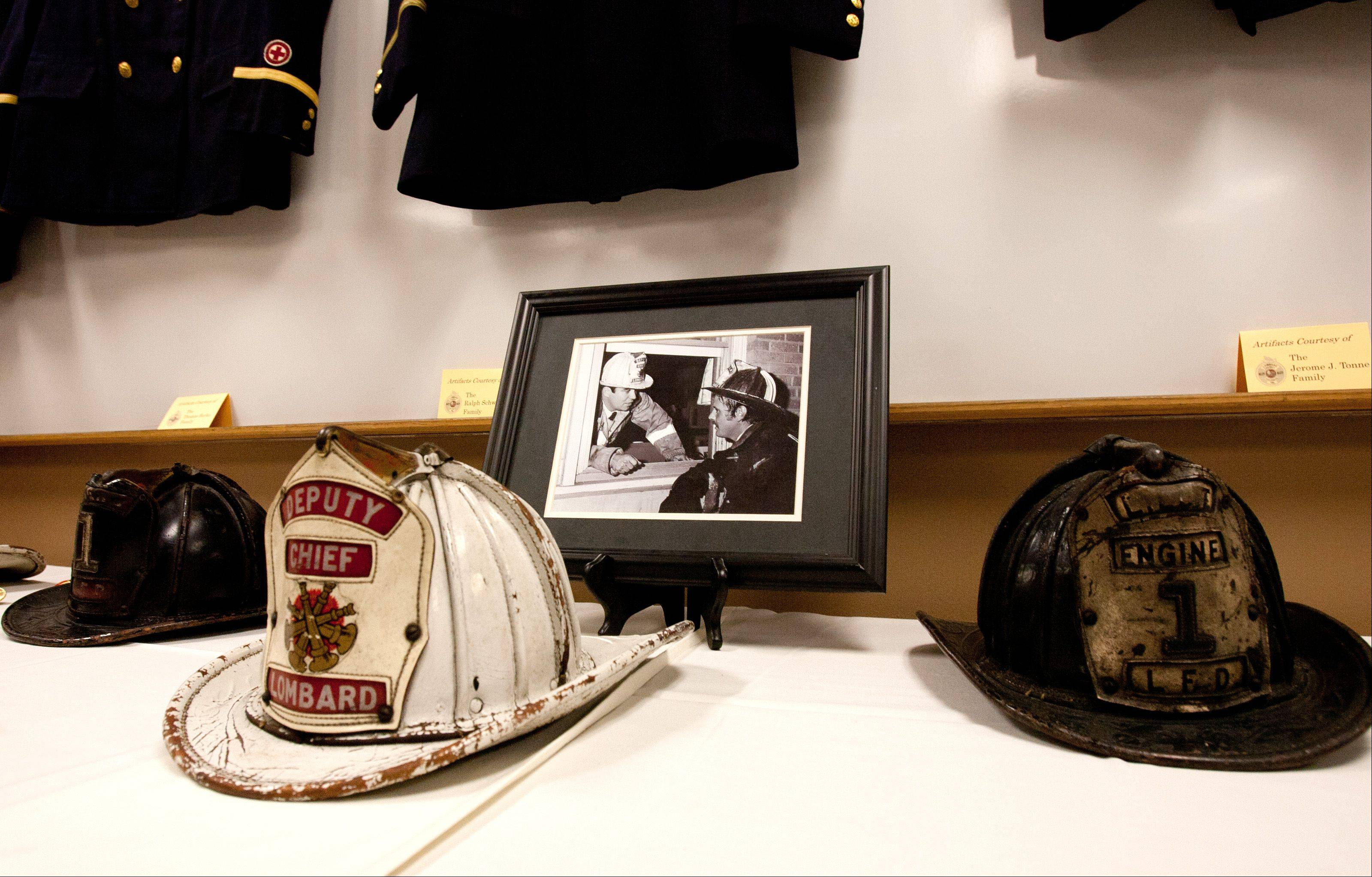 Artifacts are displayed at Station 1 during a ceremony honoring the 100th anniversary of the Lombard Fire Department.