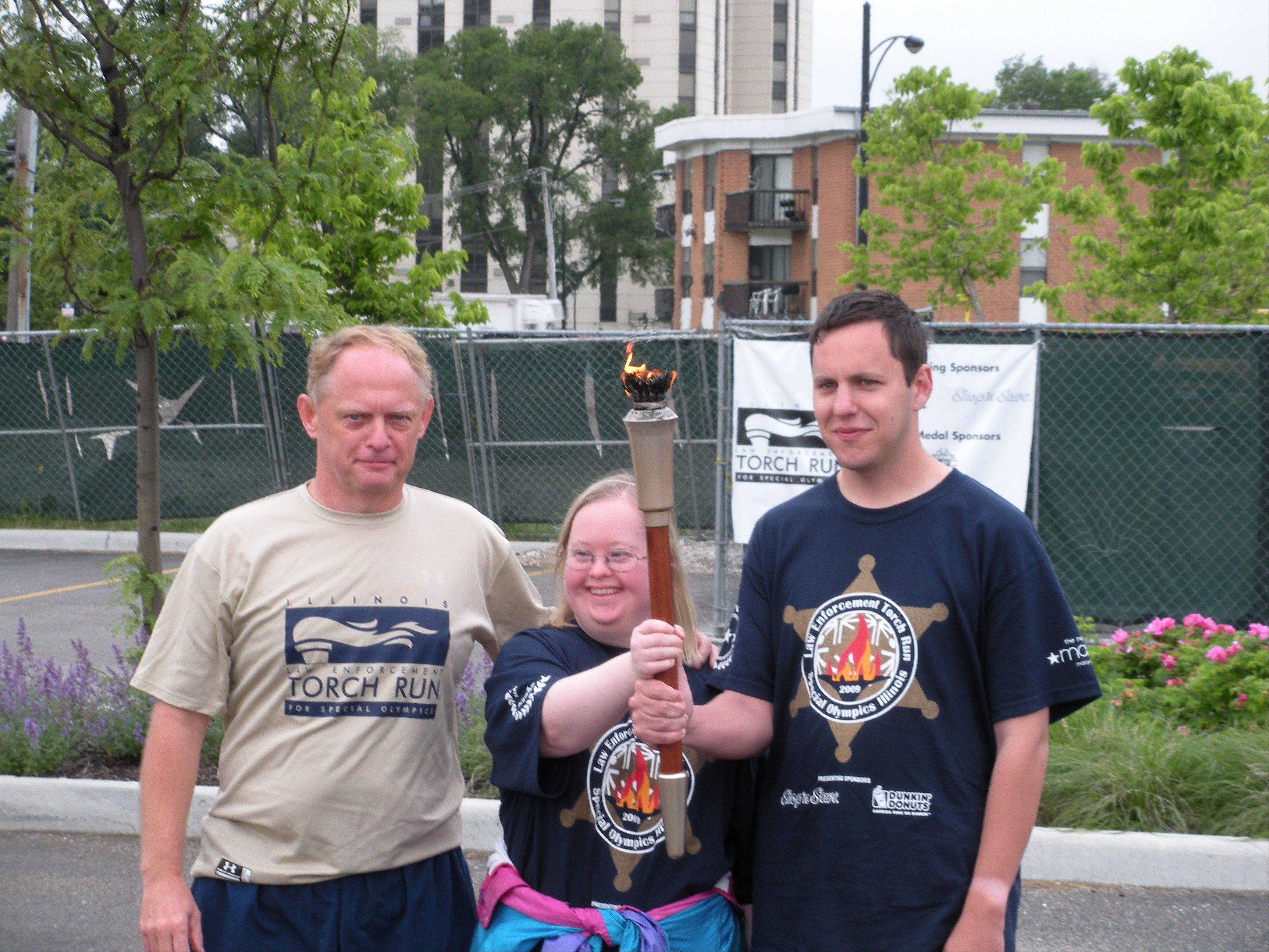 From left, Ken Veach, Molly Veach and Kenny O'Reilly, son of retired Cook County sheriff's officer Kit O'Reilly, after they competed in the World Games in Dublin.