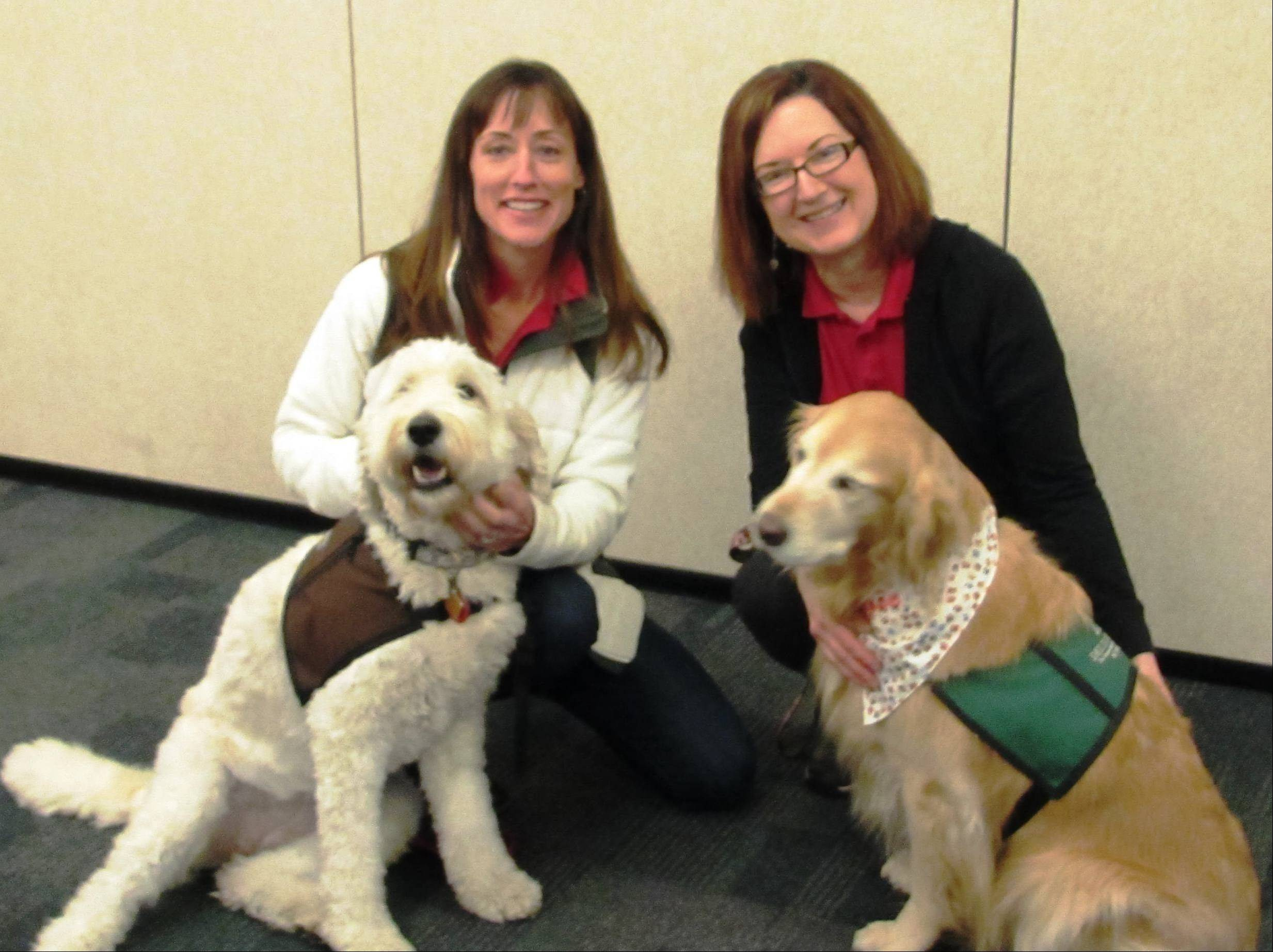 The Hinsdale Humane Society brought in trained therapy dogs to help teens deal with the stress of final exams while studying this weekend at the Downers Grove Public Library. Gay Pollitt, left, with her dog, Delilah, and Mary Beth Turek with her dog, Maggie, were part of a team that visited with nearly 200 students.