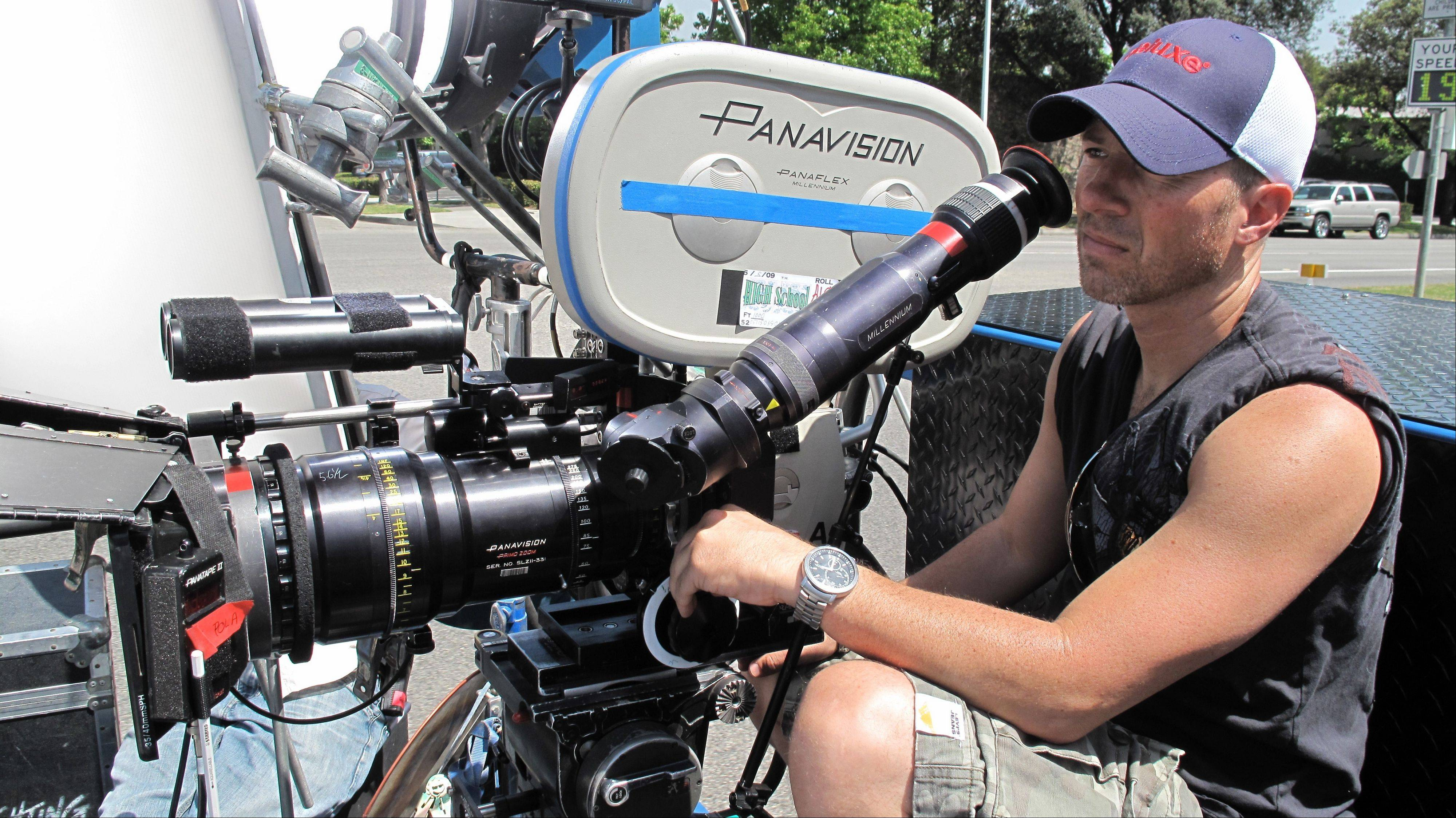 "Hollywood cinematographer and Schaumburg High School grad Paolo Cascio readies a shot on the Pasadena set of the movie ""High School."""