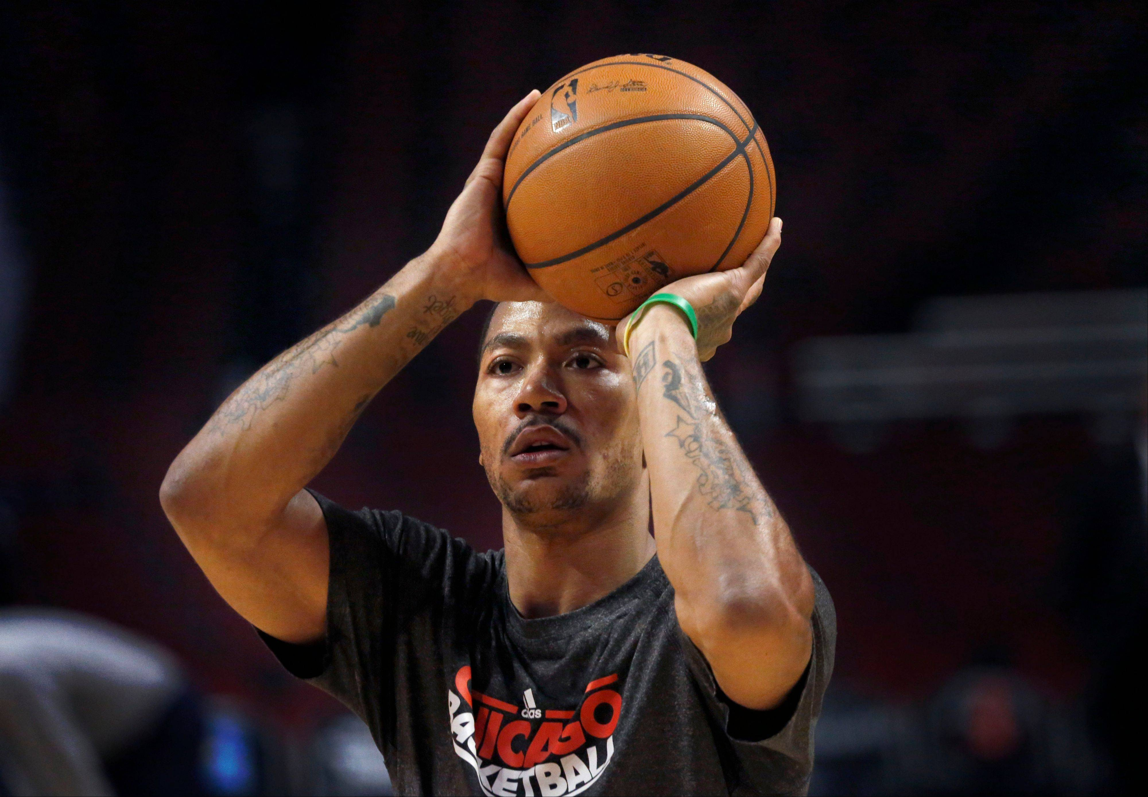 Bulls guard Derrick Rose works out with the team before Monday night's game against the Atlanta Hawks.