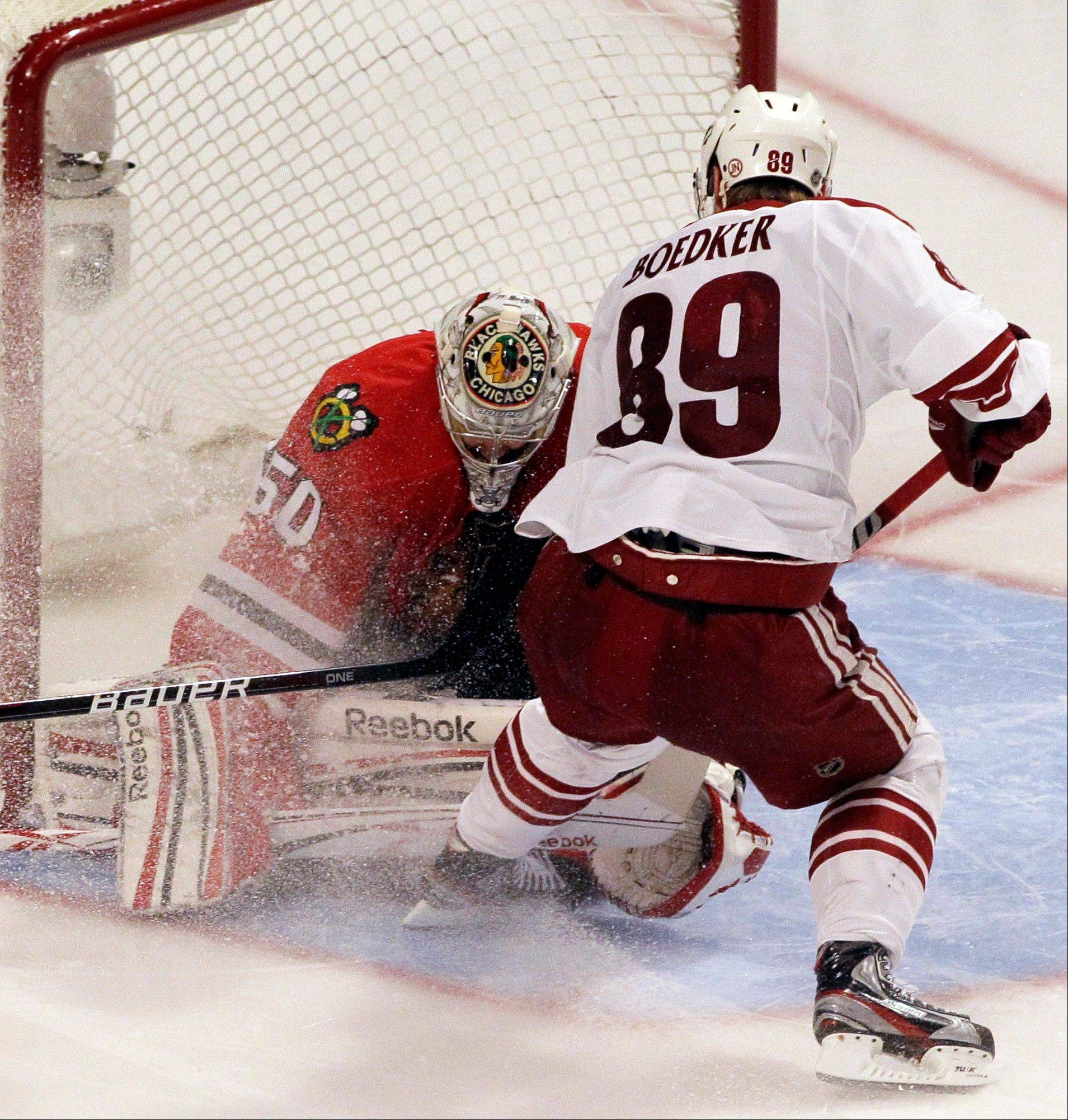 Mikkel Boedker scores a game-winning goal against Blackhawks goalie Corey Crawford in overtime of their Game 4 match in the NHL first-round playoffs last April. Boediker also scored in overtime in Game 3 of the series.