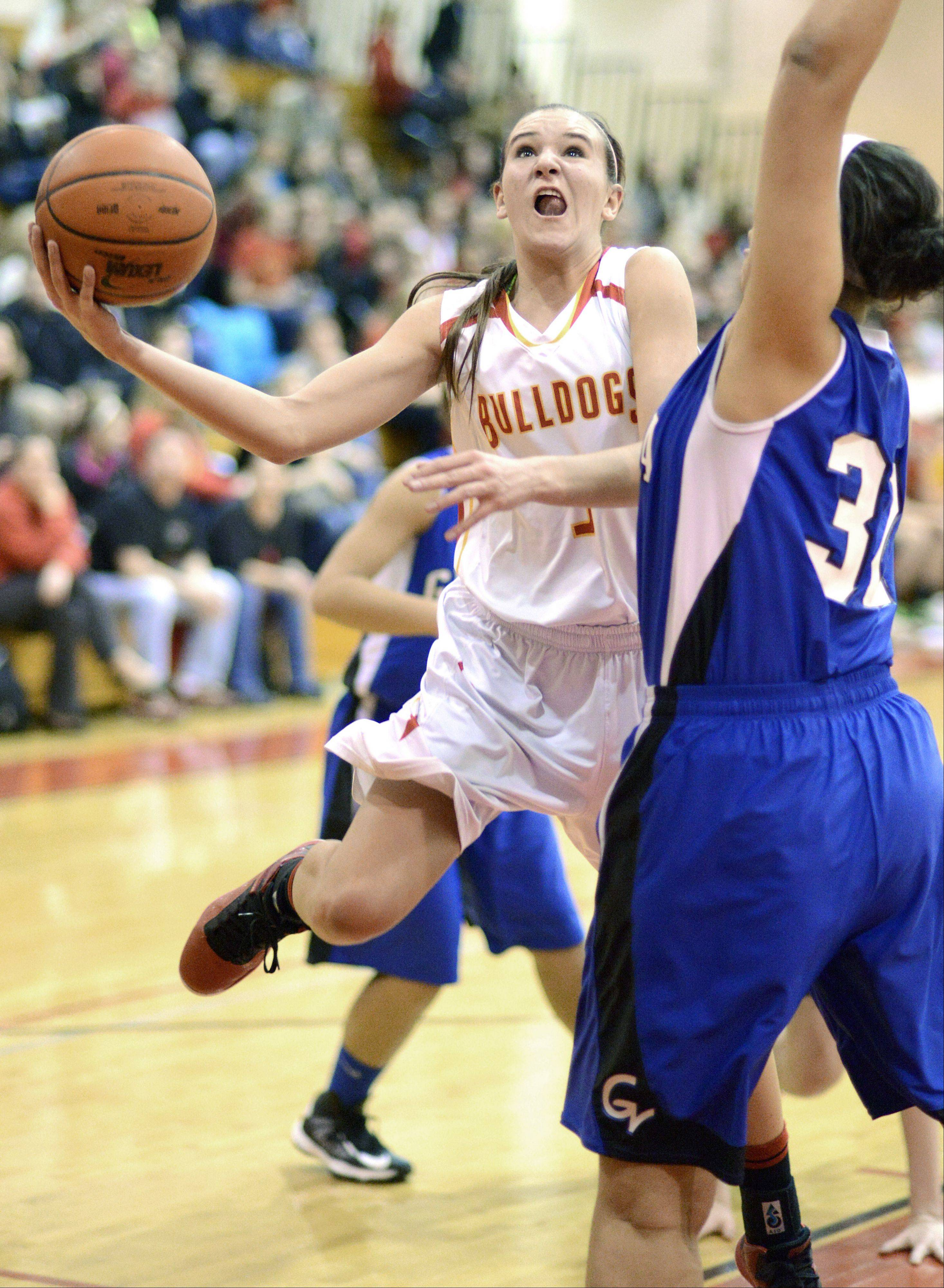 Geneva's Sidney Santos attempts to block a shot by Batavia's Liza Fruendt during Friday's game.