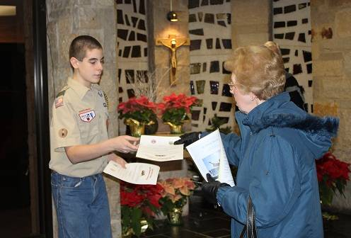 Patrick hands out flyers at St. Emily Church to help promote his Eagle Scout Service Project.
