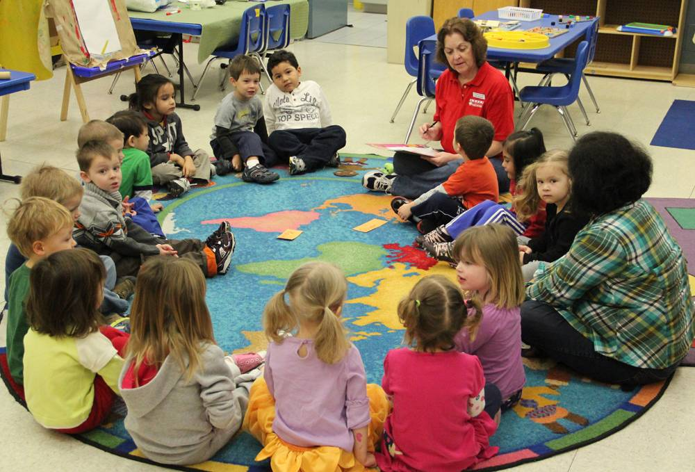 Preschoolers do an educational activity during circle time at Meineke Recreation Center.
