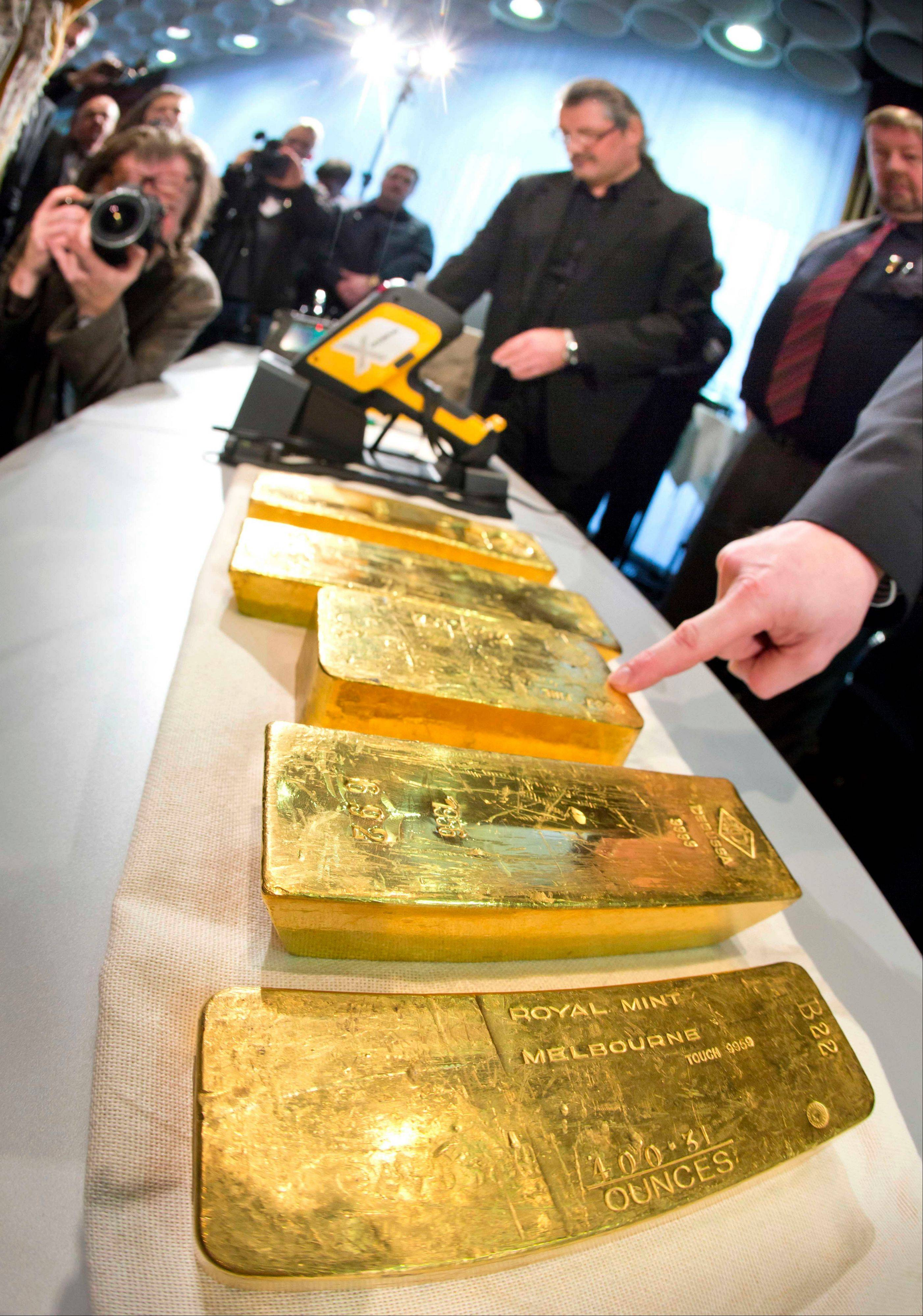 Gold ingots are on display during a press conference of Germany�s Central Bank Wednesday at their headquarters in Frankfurt.