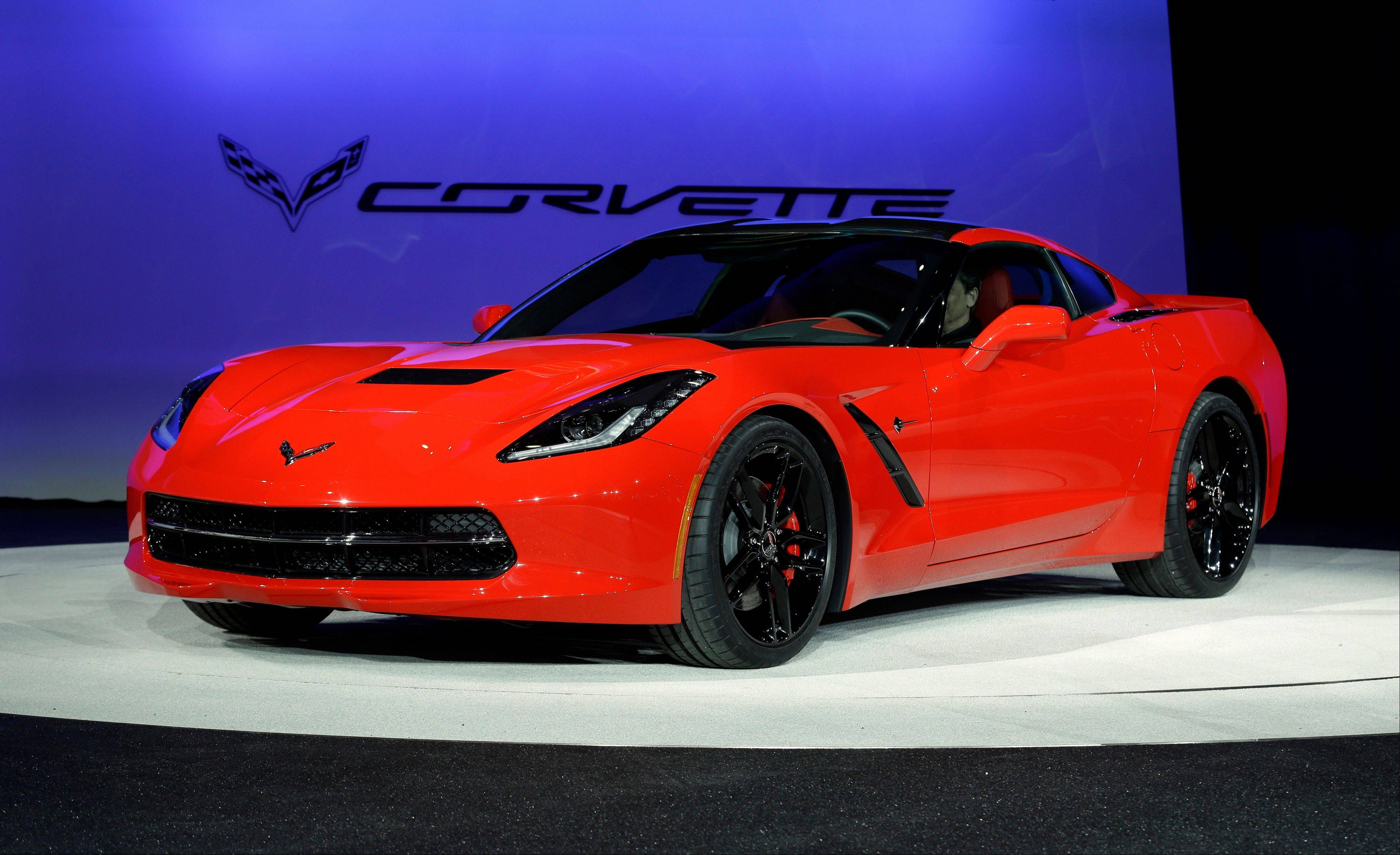 The 2014 Chevrolet Corvette Stingray is revealed at media previews for the North American International Auto Show in Detroit. Maybe it was the brand new, bright red Chevrolet Corvette gleaming in one corner, or the elegant BMW coupe in the other, but car companies were positively giddy this week as the North American International Auto Show opened in Detroit.