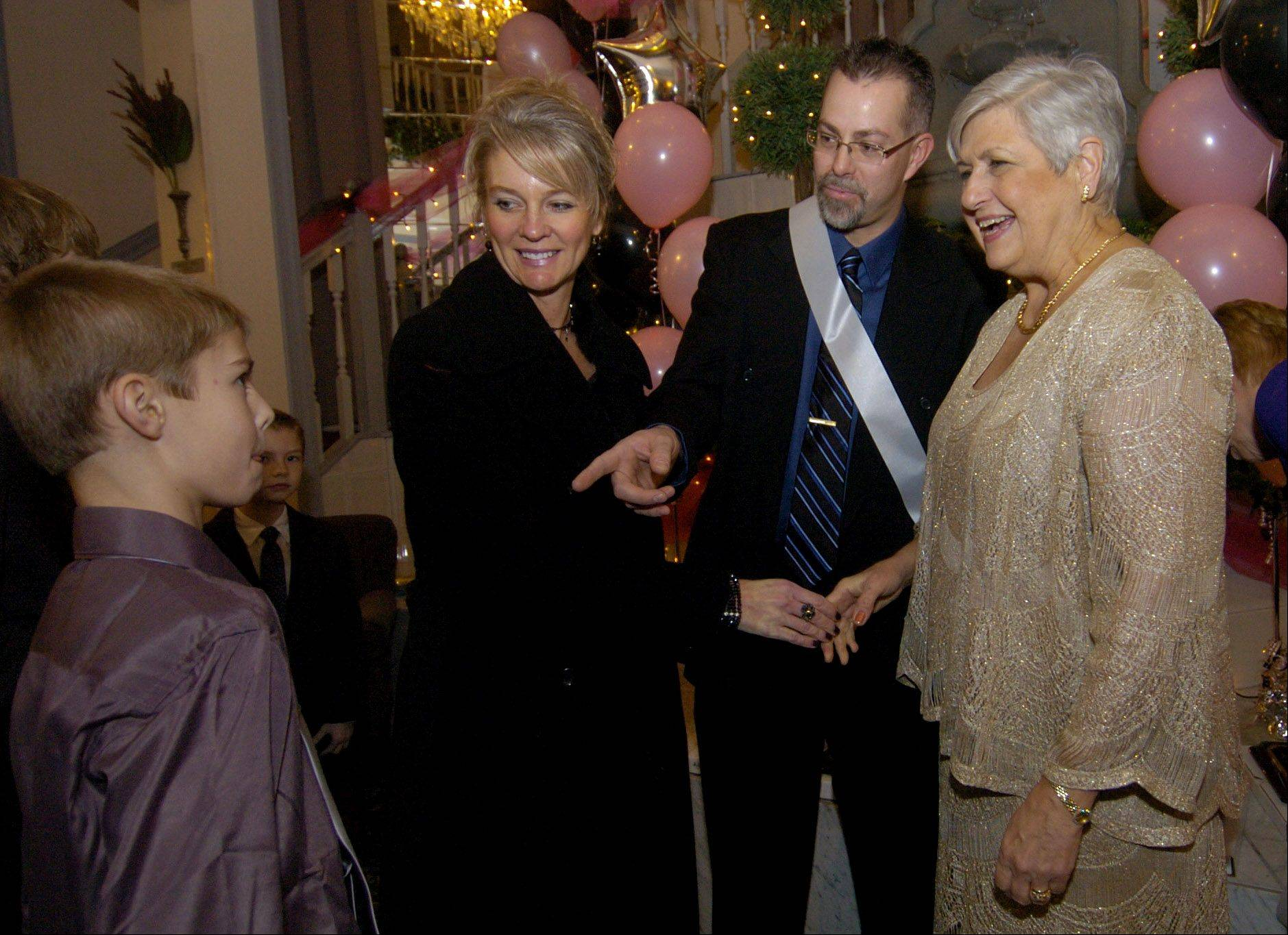 Mount Prospect Mayor Irvana Wilks, right, meets with resident Mike Jensen and his family during last year�s Celestial Celebration banquet. This year�s event, highlighted by the awarding of �Shining Star� honors, takes place Feb. 1.