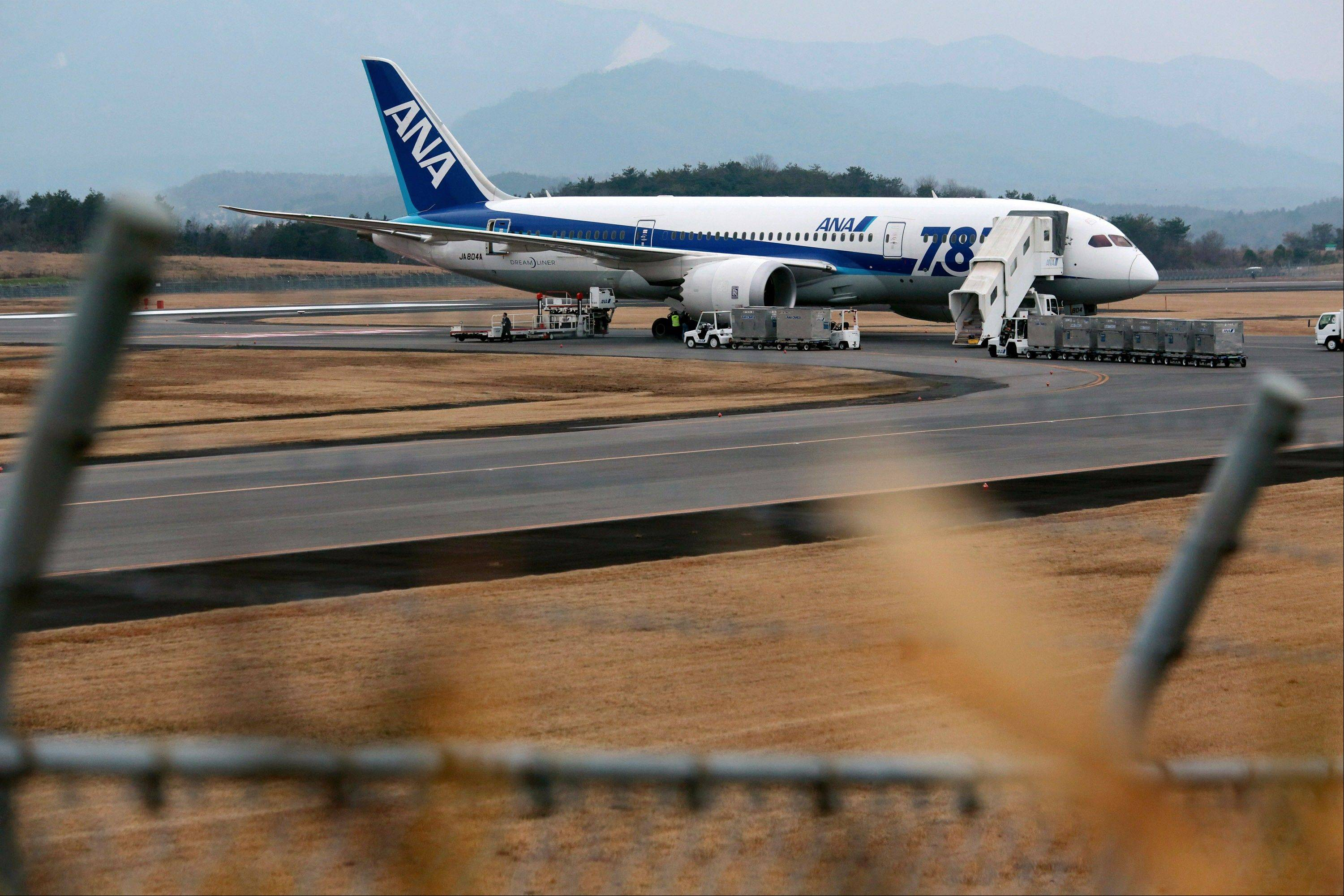A Boeing 787 Dreamliner aircraft operated by All Nippon Airways Co., which made an emergency landing, stands on the tarmac Wednesday at Takamatsu airport in Takamatsu, Kagawa Prefecture, Japan.