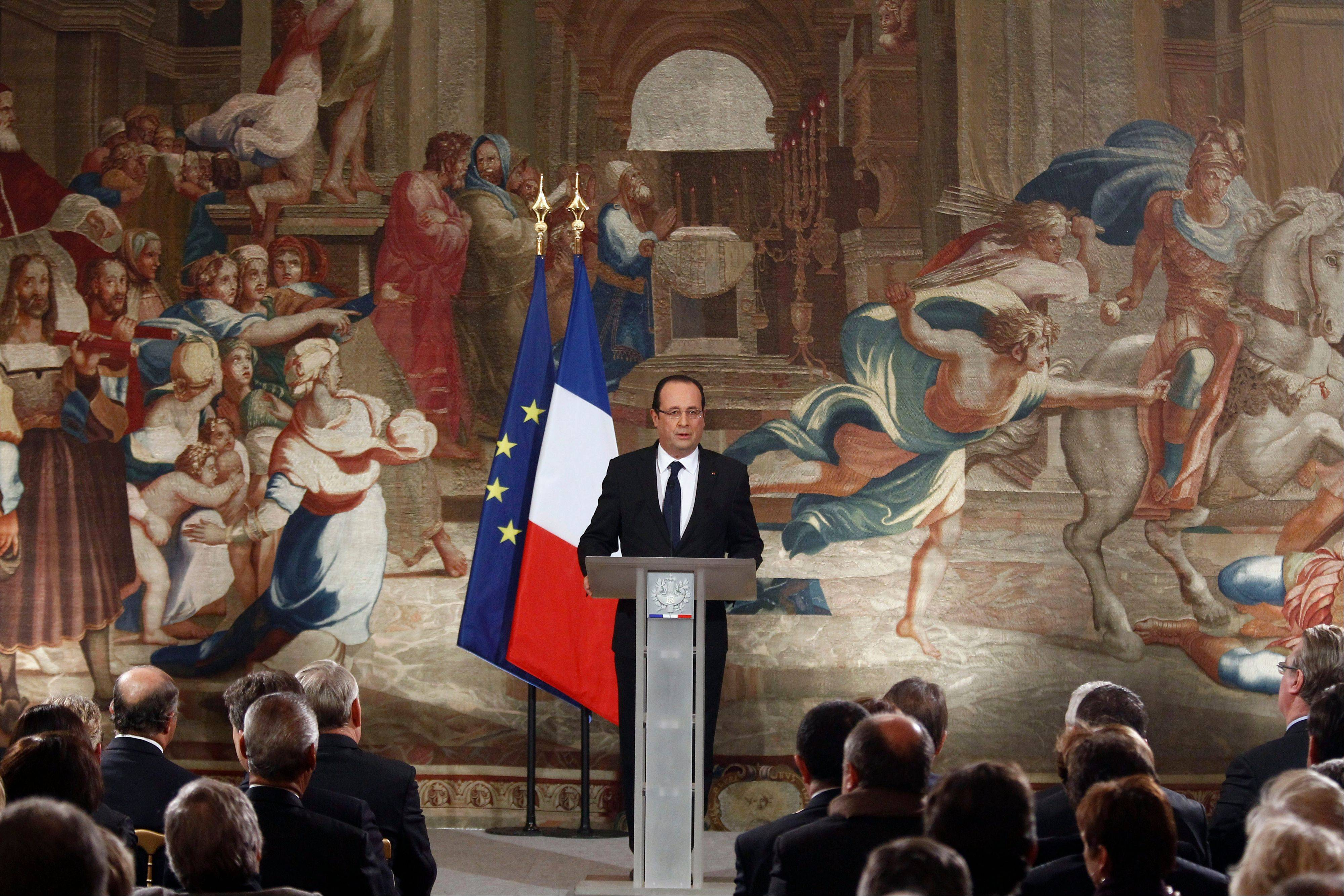 French President Francois Hollande delivers his speech Wednesday during the New Year wishes ceremony to members of Parliament, at the Elysee Palace in Paris.