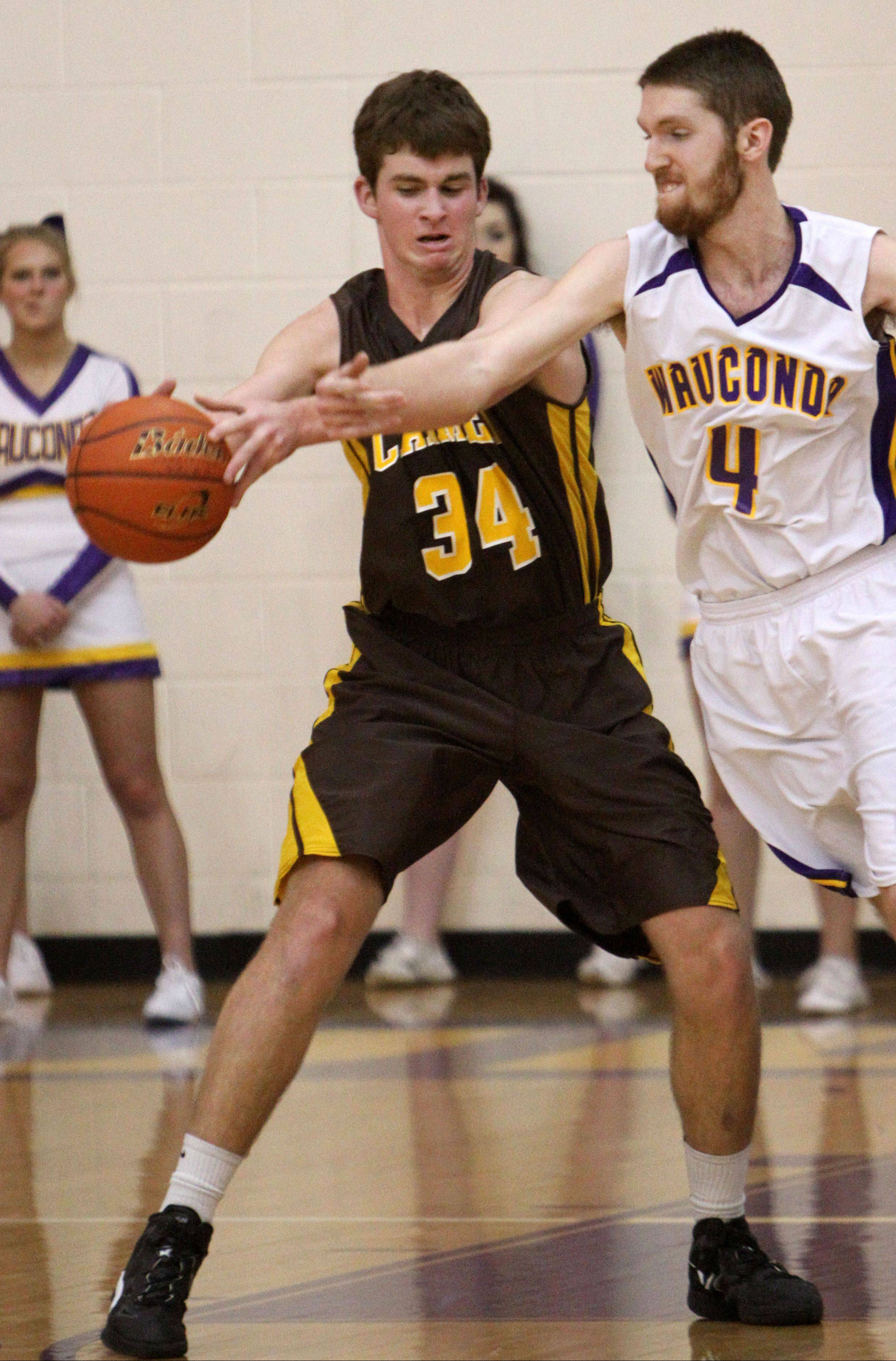 Wauconda�s Ricky Sidlowski, right, tries to steal the ball from Carmel�s Cullen Barr on Wednesday night in Wauconda.