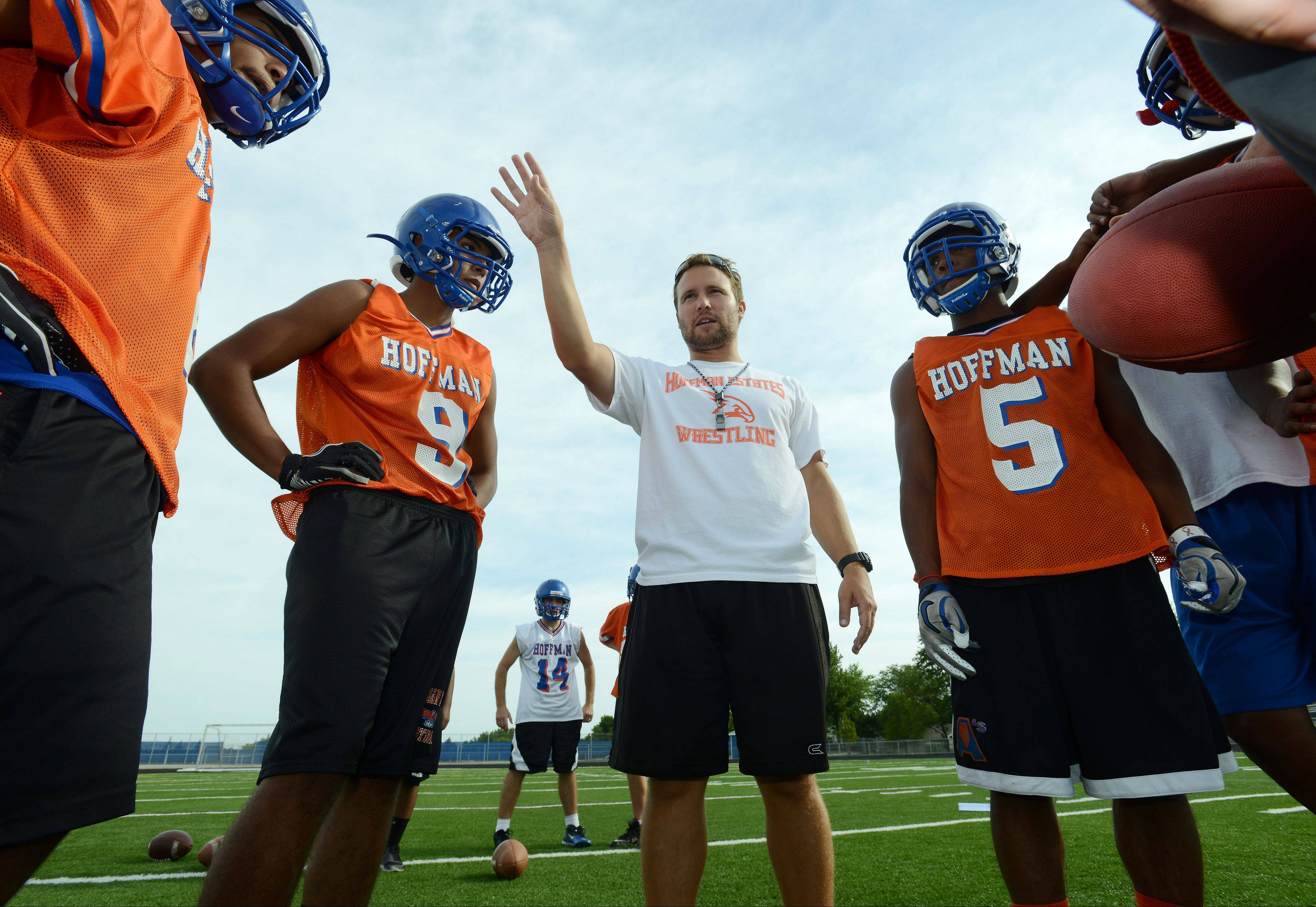 Eric Ilich directs players on the first day of practice last August at Hoffman Estates. Ilich is out as the Hawks� head coach after one season.