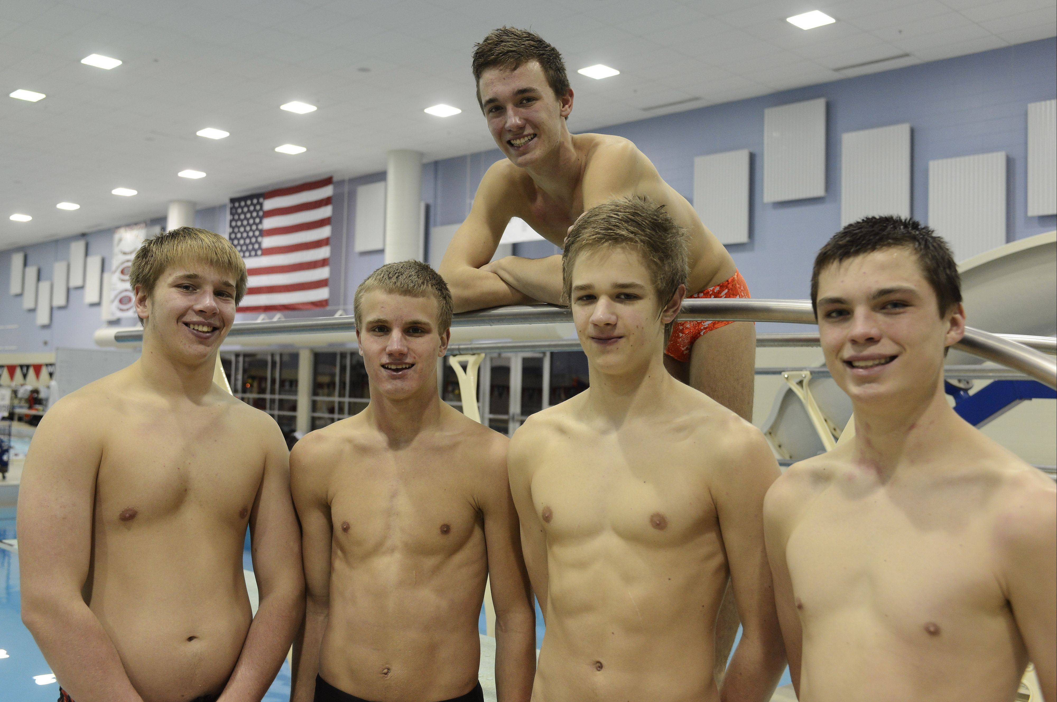 Hersey�s boys divers � front row from left Tucker Fenwick, Jack Kintzle, Danny Obyrlacz and Joey McGovern, with team captain Mat Obstoj above � have outscored each of their dual-meet opponents this season.