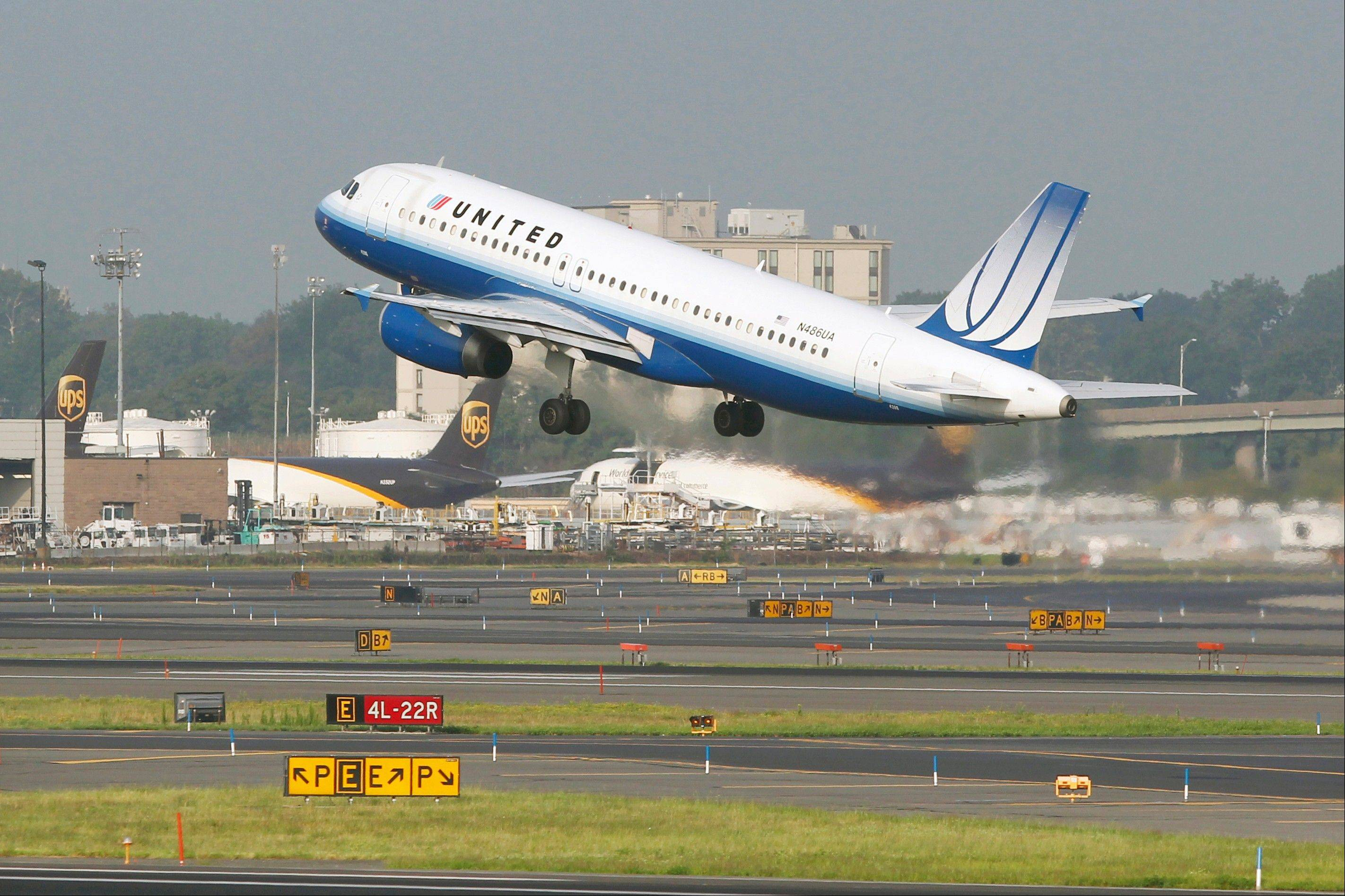 A United airlines passenger plane takes off at Newark Liberty International airport in Newark, N.J.
