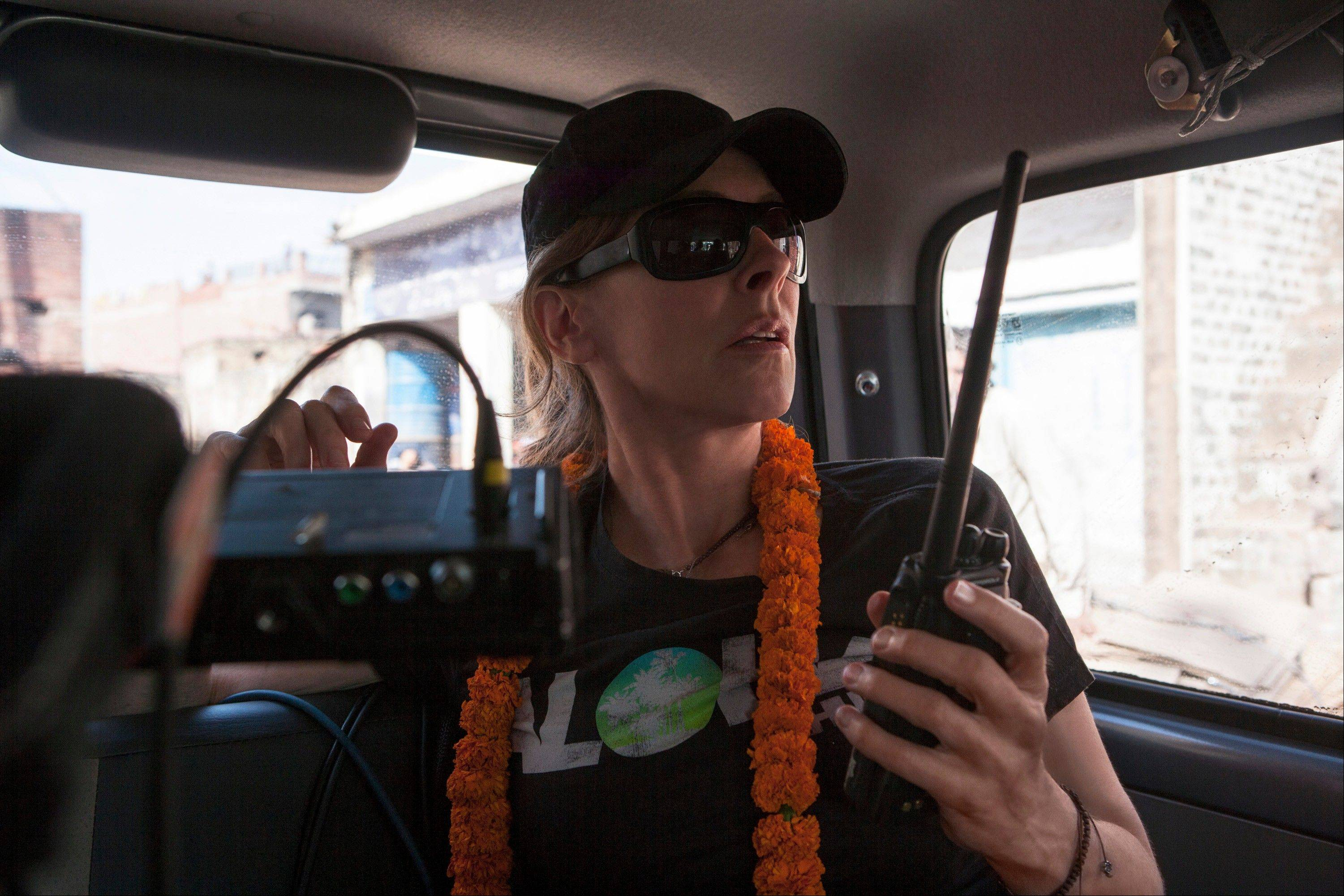 "Director/producer, Kathryn Bigelow, on the set of ""Zero Dark Thirty,"" which chronicles the decade-long search for Osama bin Laden."