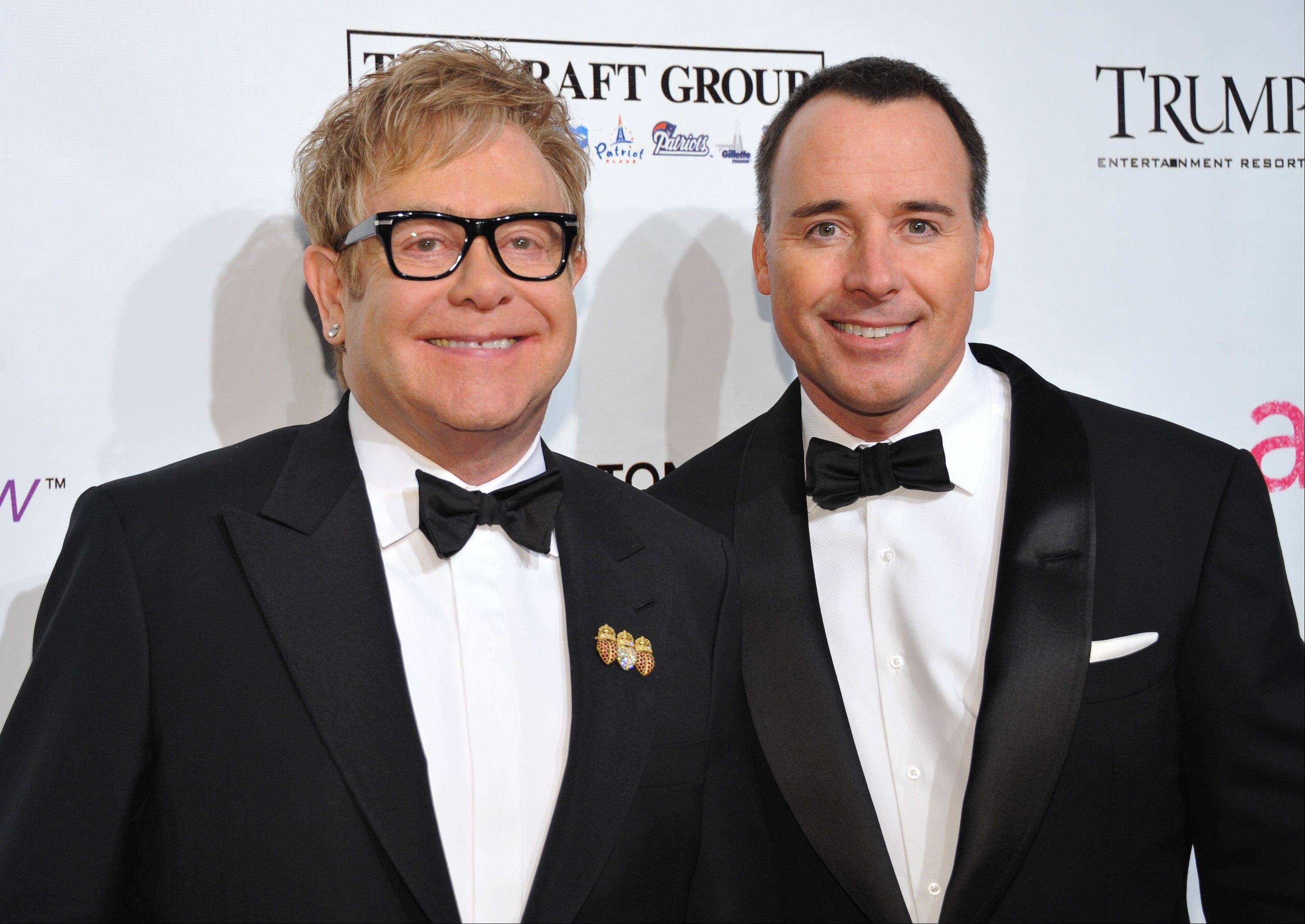 Sir Elton John, left, and David Furnish say they have become parents for a second time.