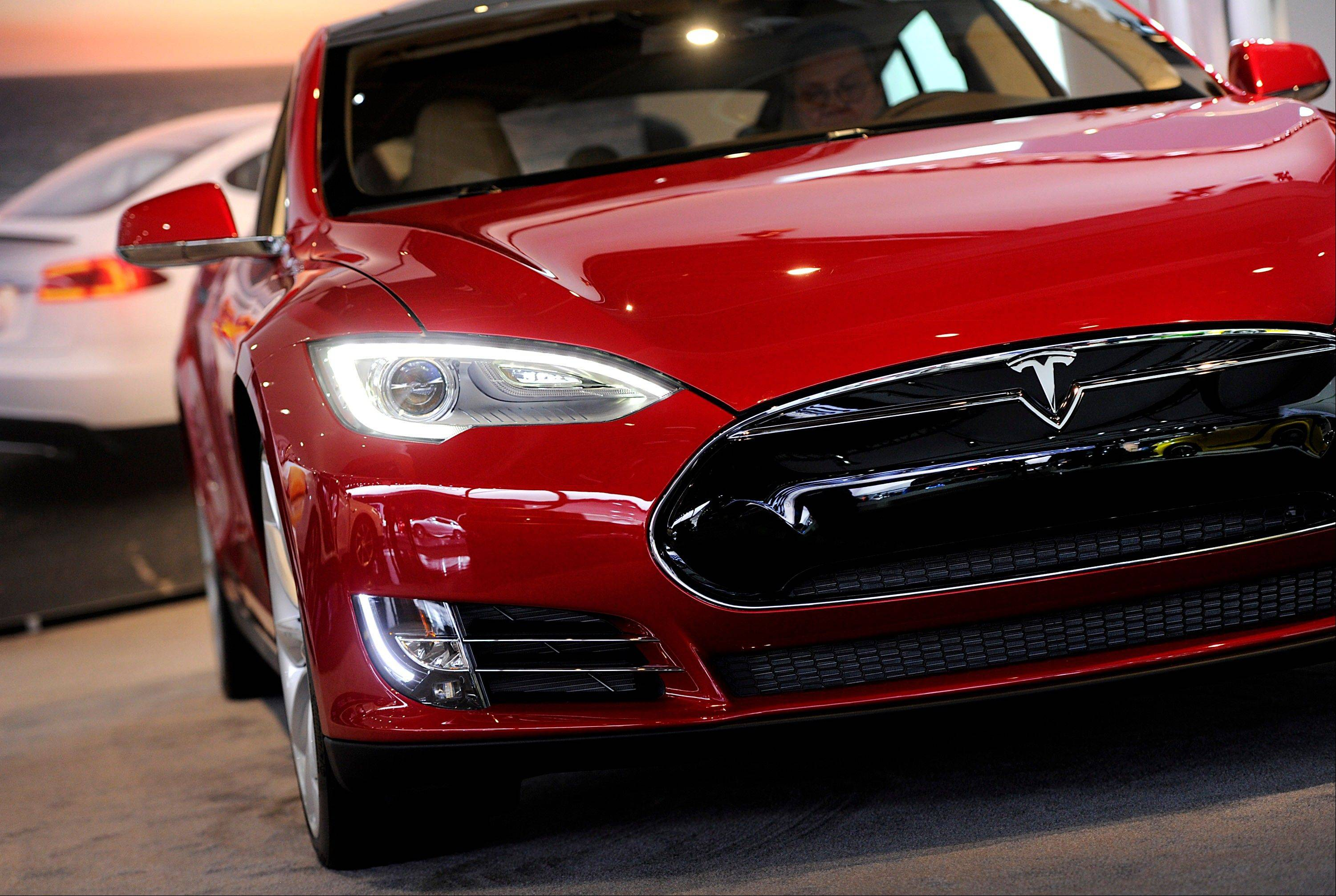A Tesla Motors Inc. vehicle is displayed during the 2013 North American International Auto Show (NAIAS) in Detroit, Michigan, U.S., on Tuesday, Jan. 15, 2013. The Detroit auto show runs through Jan. 27 and will display over 500 vehicles, representing the most innovative designs in the world.