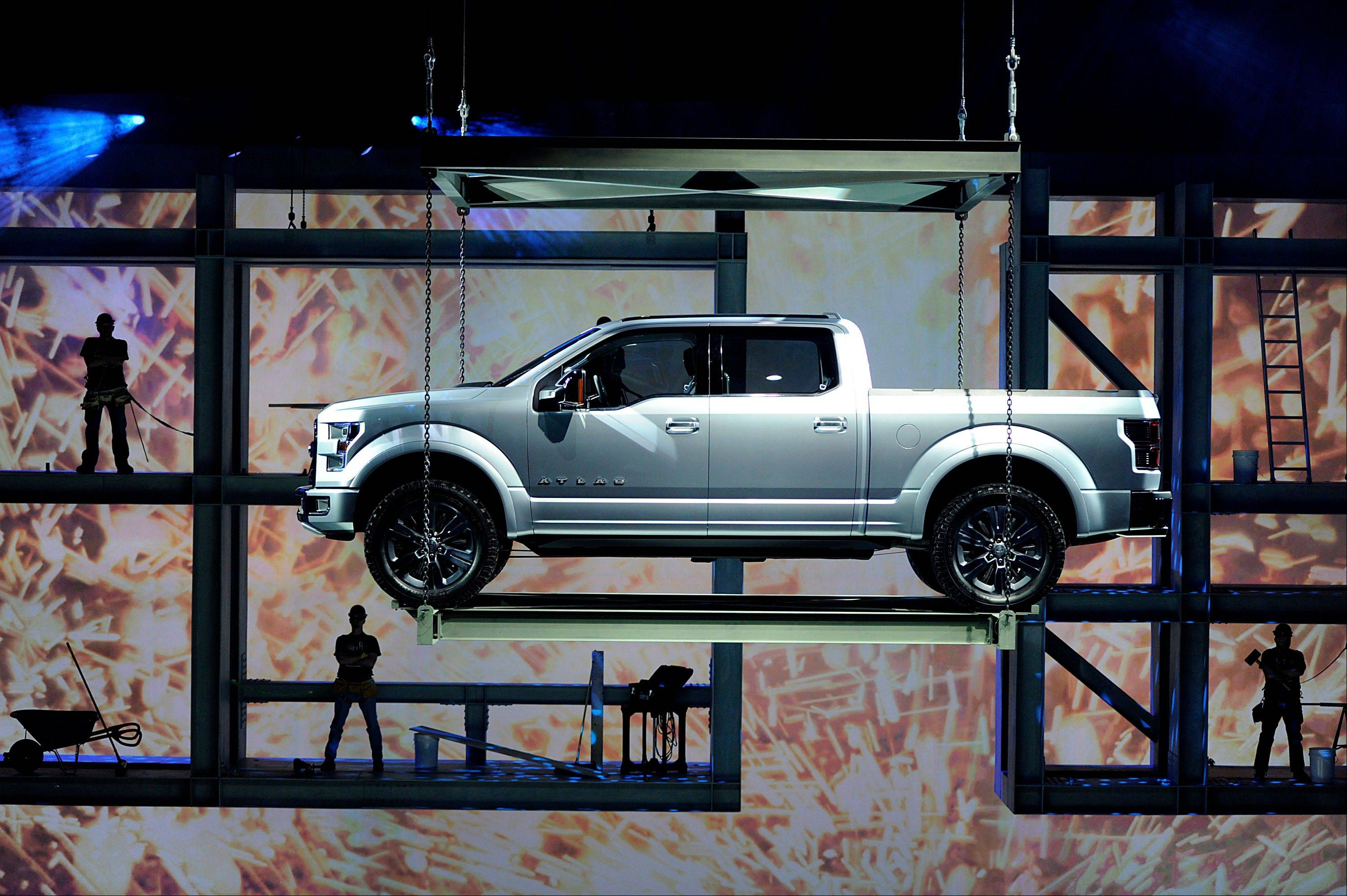 The Ford Motor Co. F-150 Atlas concept truck is lowered during it's unveiling at the 2013 North American International Auto Show (NAIAS) in Detroit, Michigan, U.S., on Tuesday, Jan. 15, 2013. The Detroit auto show runs through Jan. 27 and will display over 500 vehicles, representing the most innovative designs in the world.