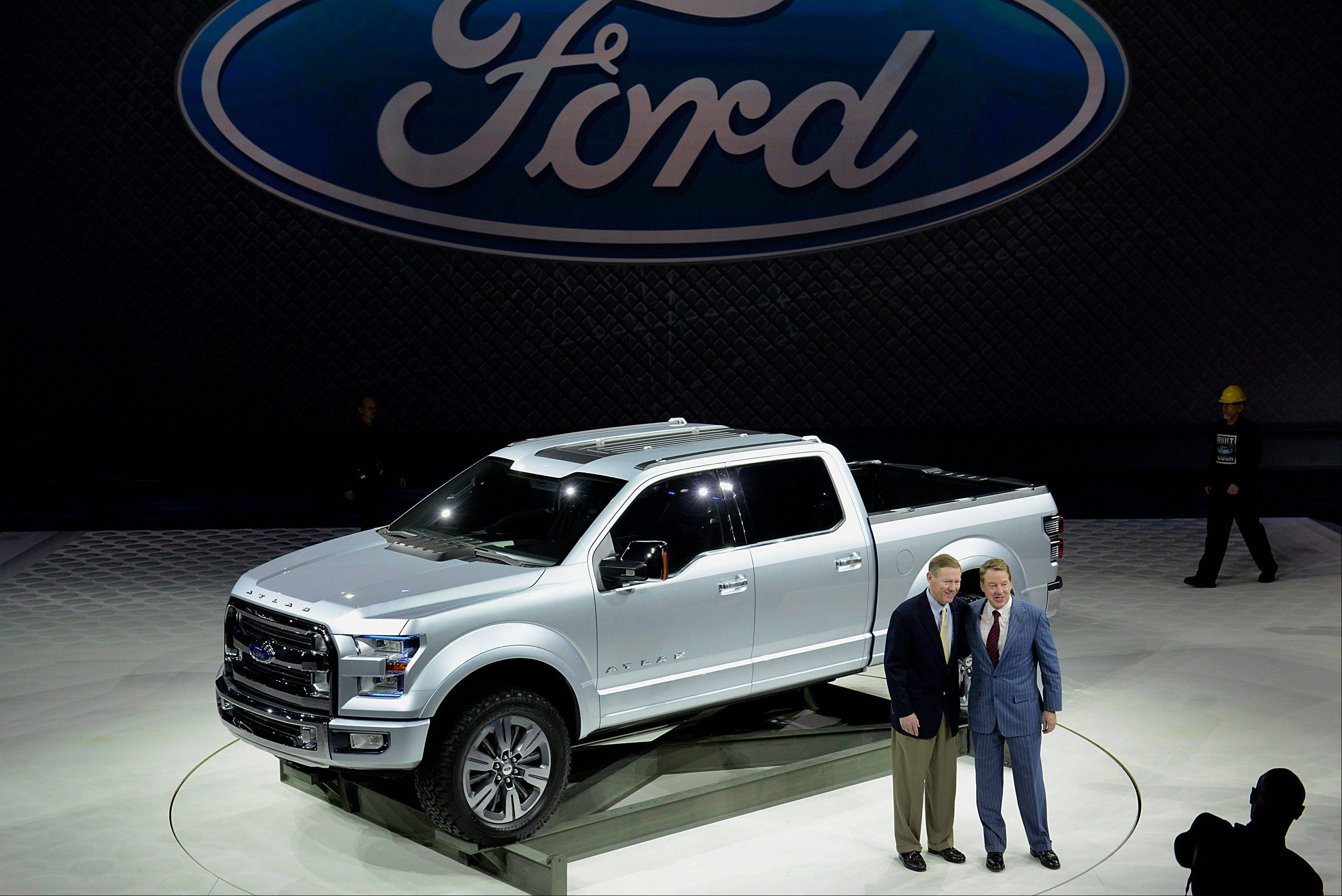Alan Mulally, president and chief executive officer of Ford Motor Co., left, and Bill Ford, executive chairman of Ford Motor Co., stand for a photograph in front of the F-150 Atlas concept truck during the 2013 North American International Auto Show (NAIAS) in Detroit, Michigan, U.S., on Tuesday, Jan. 15, 2013.
