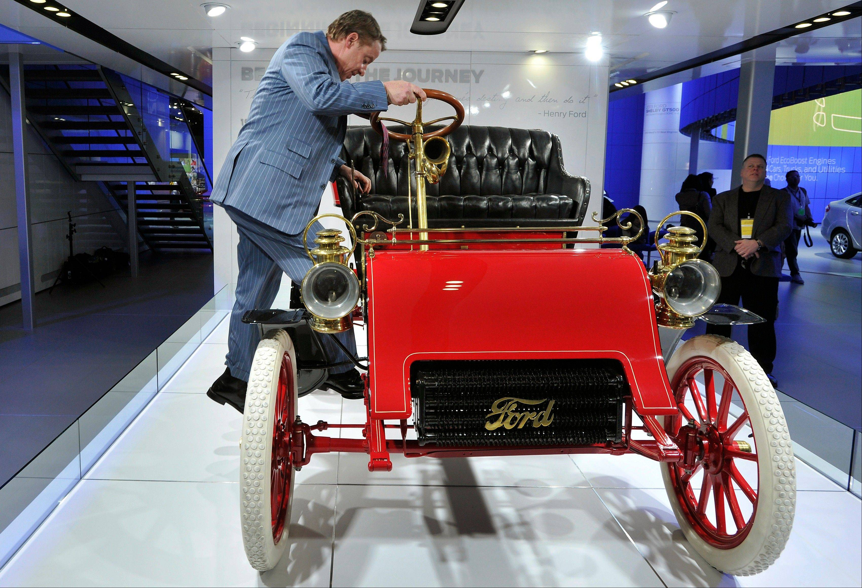 Ford Motor Companys Executive Chairman William Clay Ford Jr. climbs into a 1903 Model A, the oldest surviving Ford Car, displayed at the Ford exhibit at the North American International Auto Show at Cobo Center in Detroit, on Tuesday, Jan. 15, 2013.
