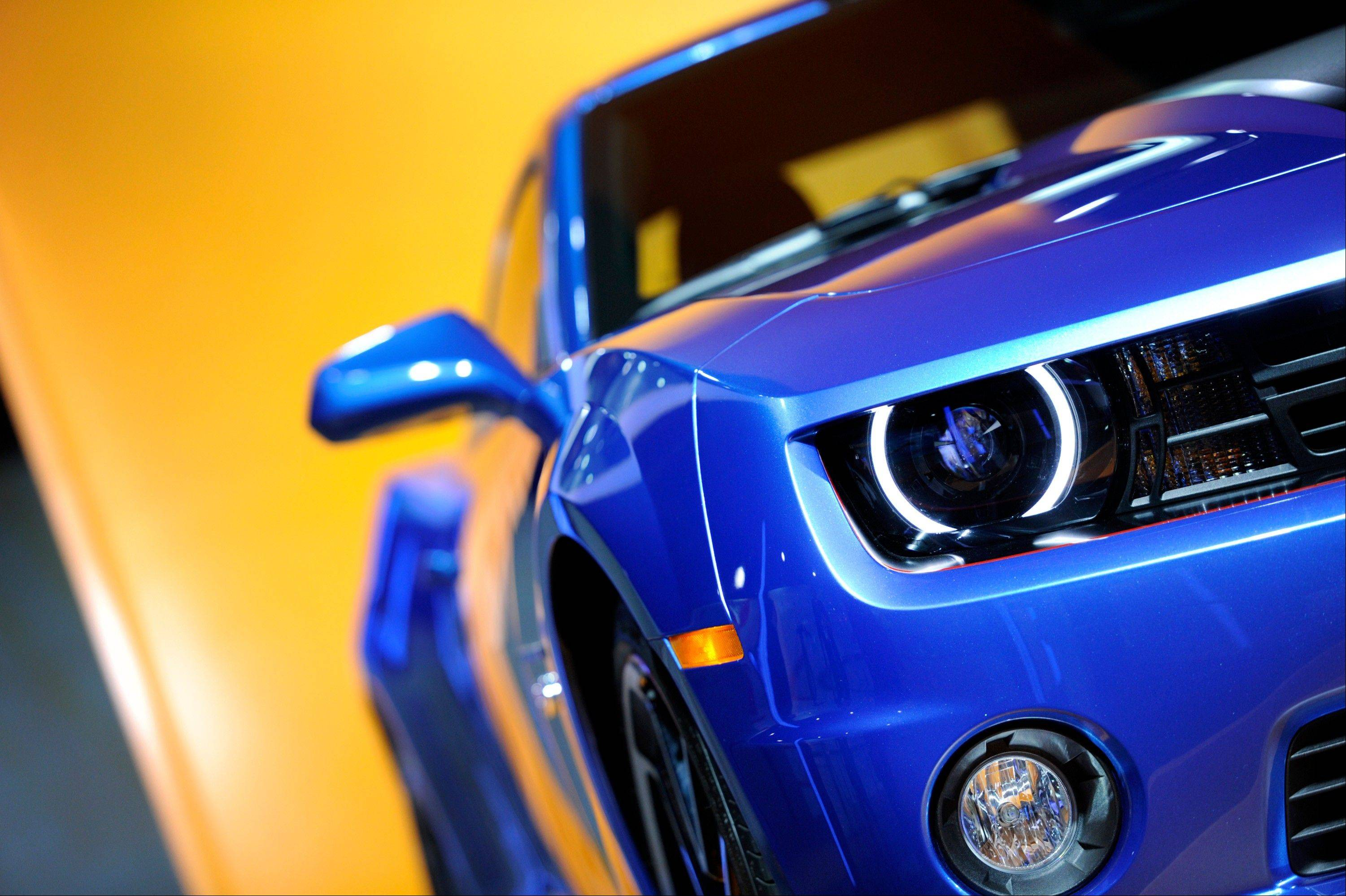 A headlight of the Chevrolet Camaro Hot Wheels edition vehicle is seen during the 2013 North American International Auto Show (NAIAS) in Detroit, Michigan, U.S., on Tuesday, Jan. 15, 2013.
