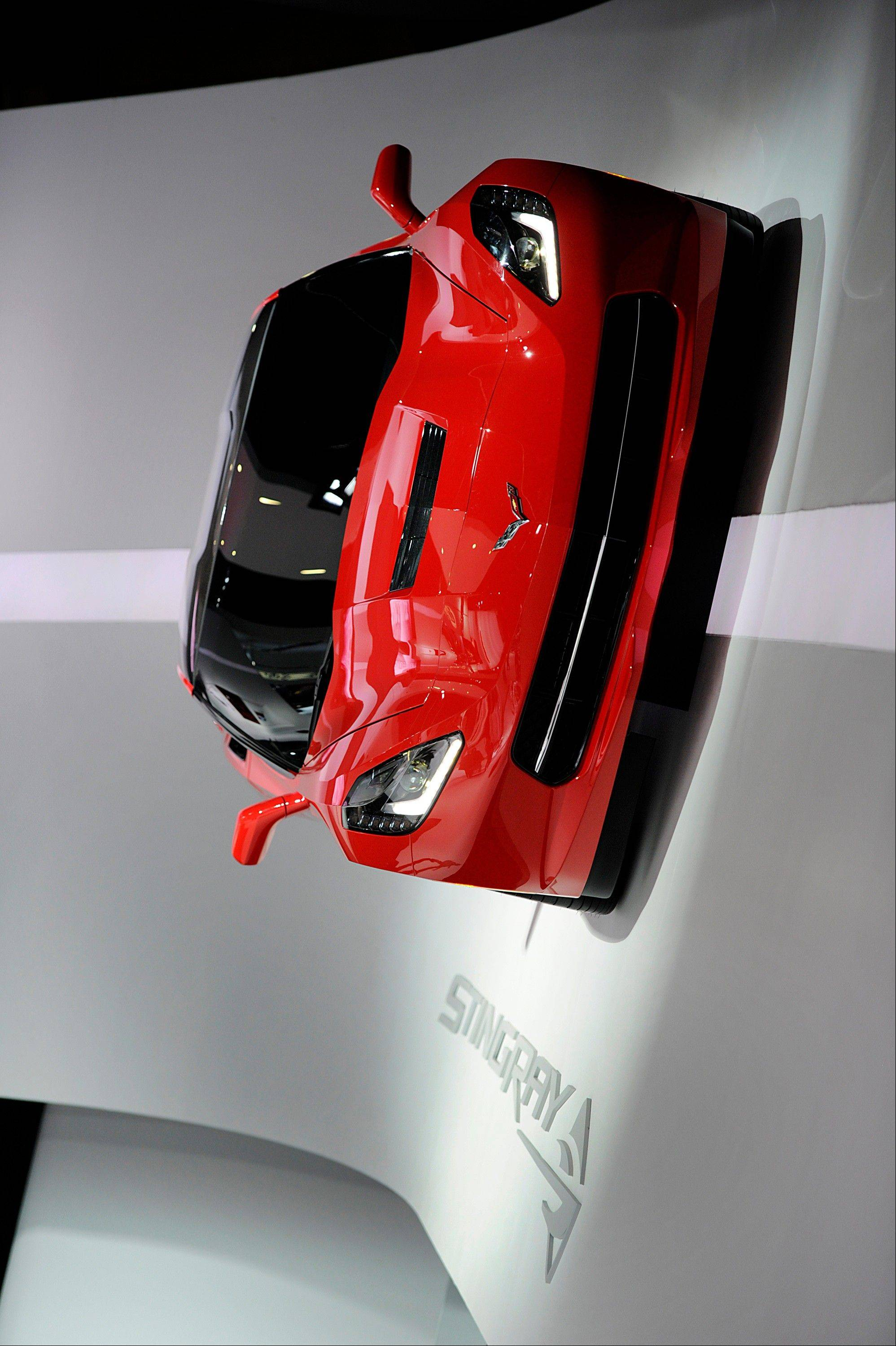 The 2014 Chevrolet Corvette Stingray is displayed on a wall during the 2013 North American International Auto Show (NAIAS) in Detroit, Michigan, U.S., on Tuesday, Jan. 15, 2013. The Detroit auto show runs through Jan. 27 and will display over 500 vehicles, representing the most innovative designs in the world.