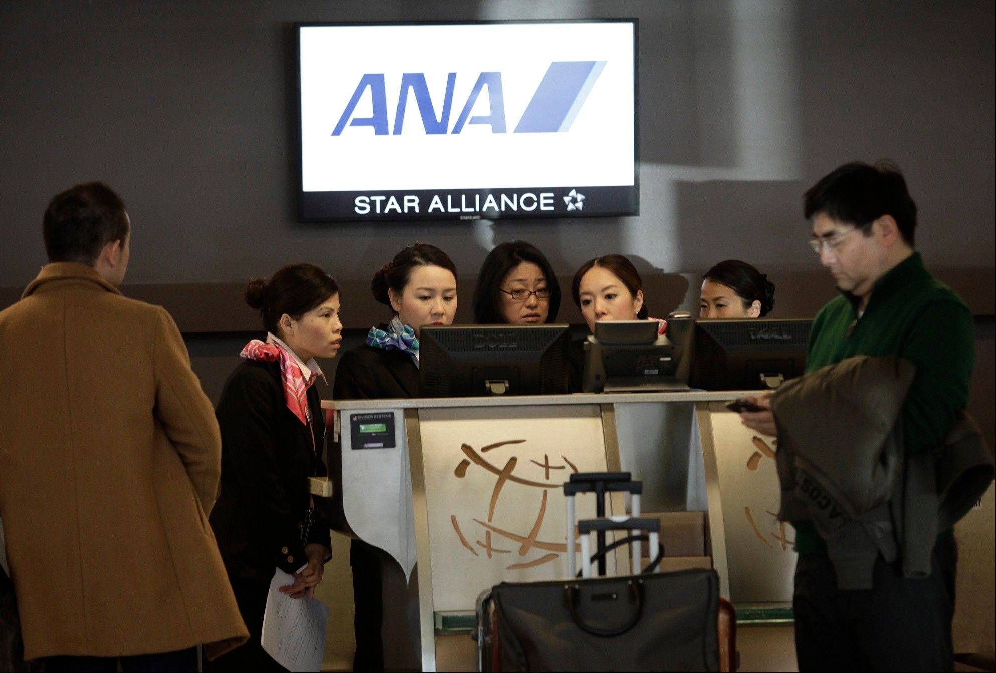 Passengers get help from the All Nippon Airways ticket counter at Mineta San Jose International Airport in San Jose, Calif. on Wednesday. ANA canceled its flight from San Jose to Tokyo Wednesday morning after authorities grounded all flights of the Boeing 787 Dreamliner.