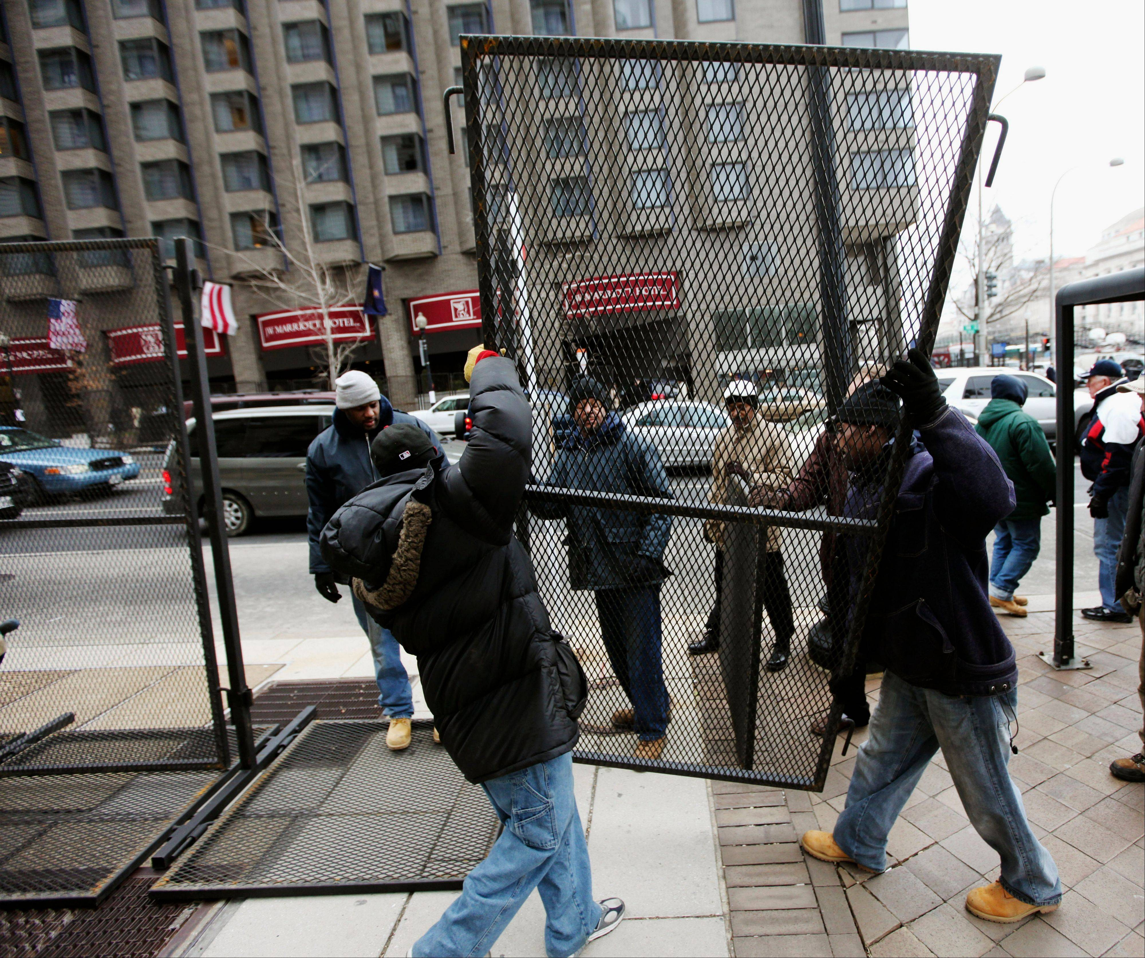 Associated Press/Jan. 18, 2009Workers install security barricades near Pennsylvania Ave. in Washington before President Obama's first inauguration. Obama's second inauguration figures to be significantly smaller than the record-breaking turnout of 2009.