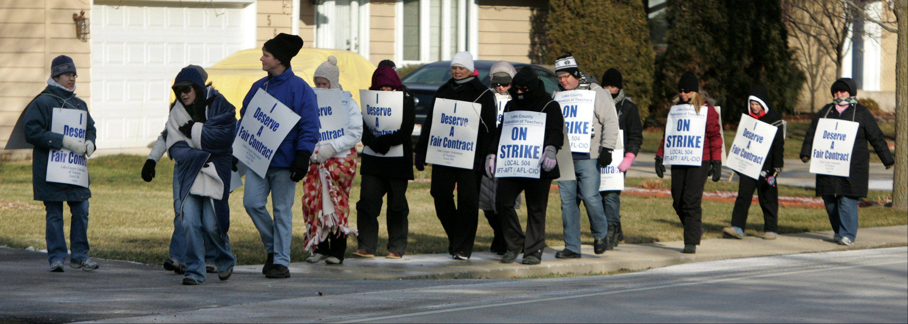 Teachers walk the picket line in the cold Wednesday outside Grayslake Middle School. The walkout affects some 325 teachers and 4,000 students at seven Grayslake Elementary District 46 schools.