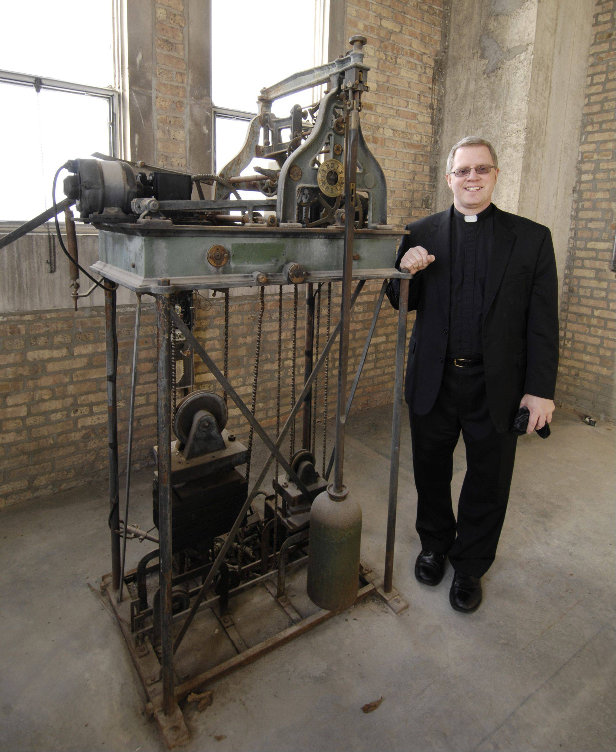 It's been 27 years since the bell-ringing mechanism has been at Ss. Peter and Paul Catholic Church in Naperville. Electronics have recreated the sound of ringing bells, but soon the Rev. Tom Milota have the chance to ring real bells again.