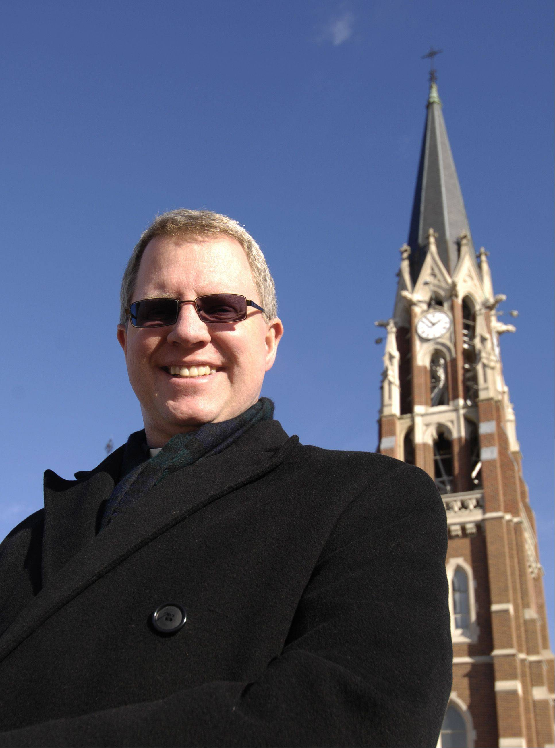 The Rev. Tom Milota of Ss. Peter and Paul church in Naperville. The church is using a gift to refurbish its bells.