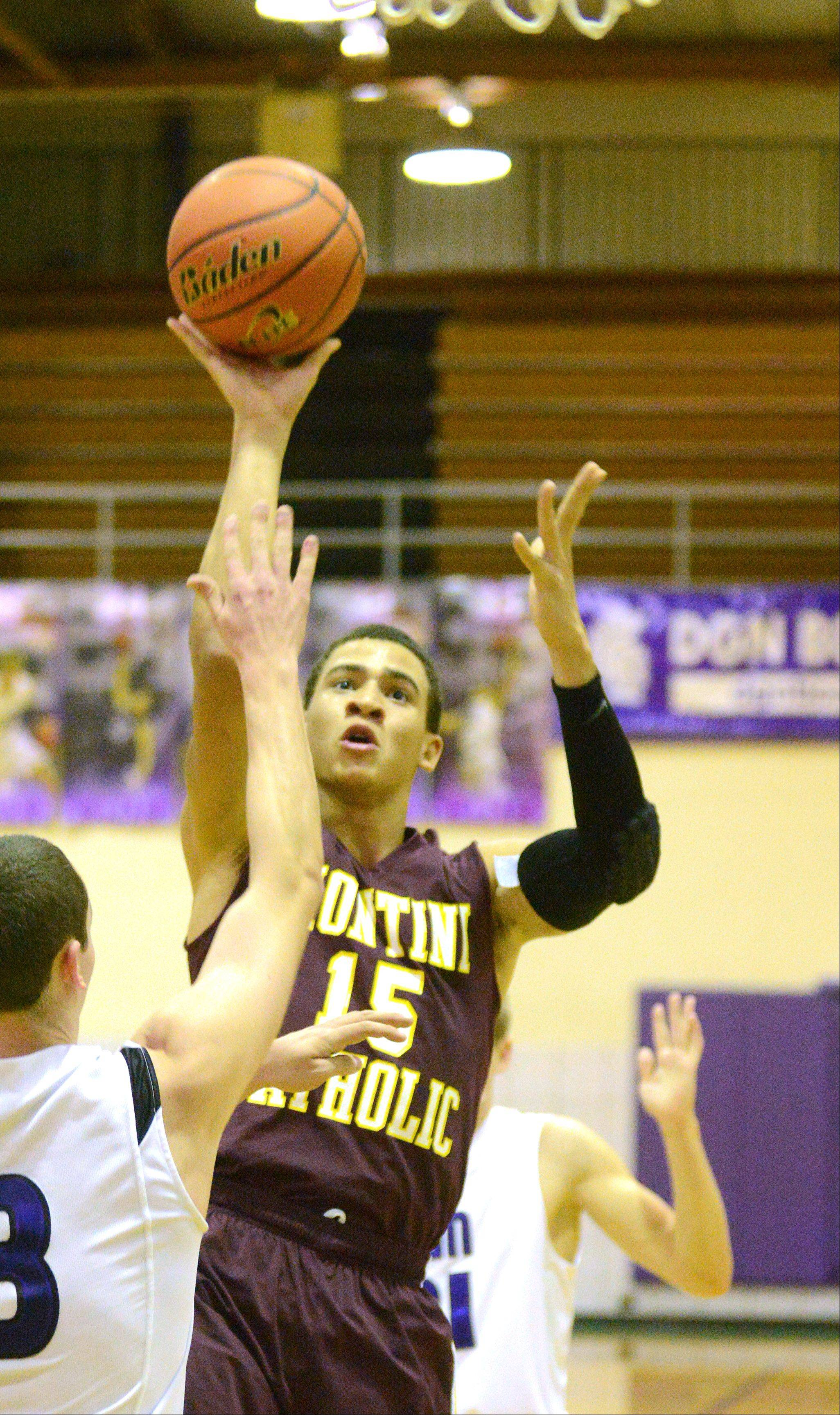 Simmie Cobbs of Montini puts up a shot.