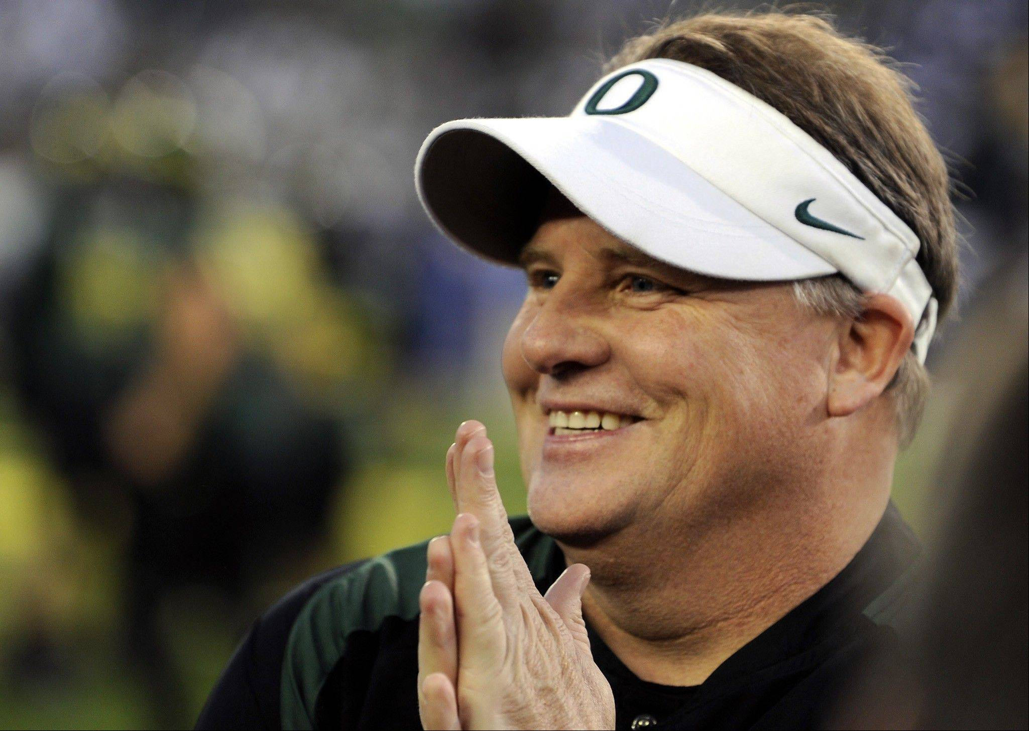 FILE - In this Dec. 2, 2011 file photo, Oregon's head coach Chip Kelly smiles before the Pac 12 championship football game against UCLA in Eugene, Ore. The Philadelphia Eagles have hired Kelly after he originally chose to stay at Oregon. Kelly becomes the 21st coach in team history and replaces Andy Reid, who was fired on Dec. 31 after a 4-12 season.