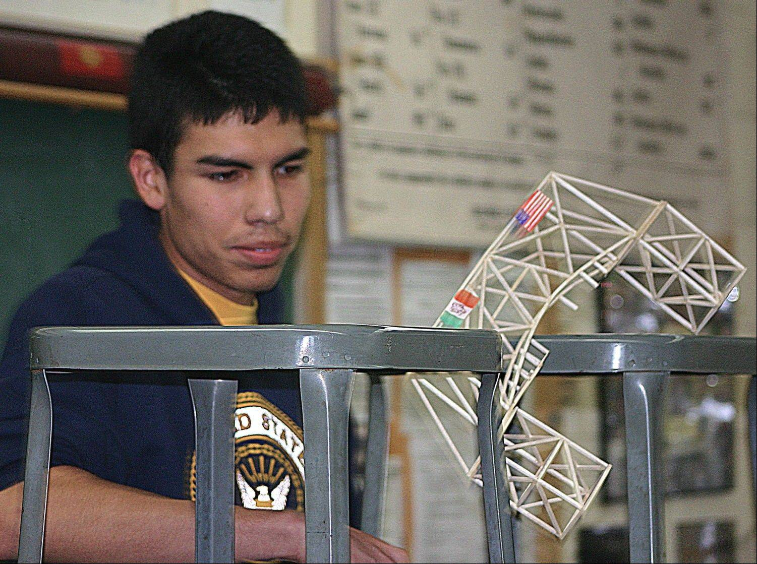 Jose Robles watches his bridge break during the Mooseheart bridge-breaking competition. Robles reattached the bucket to his design, but the second attempt ended in similar fashion.