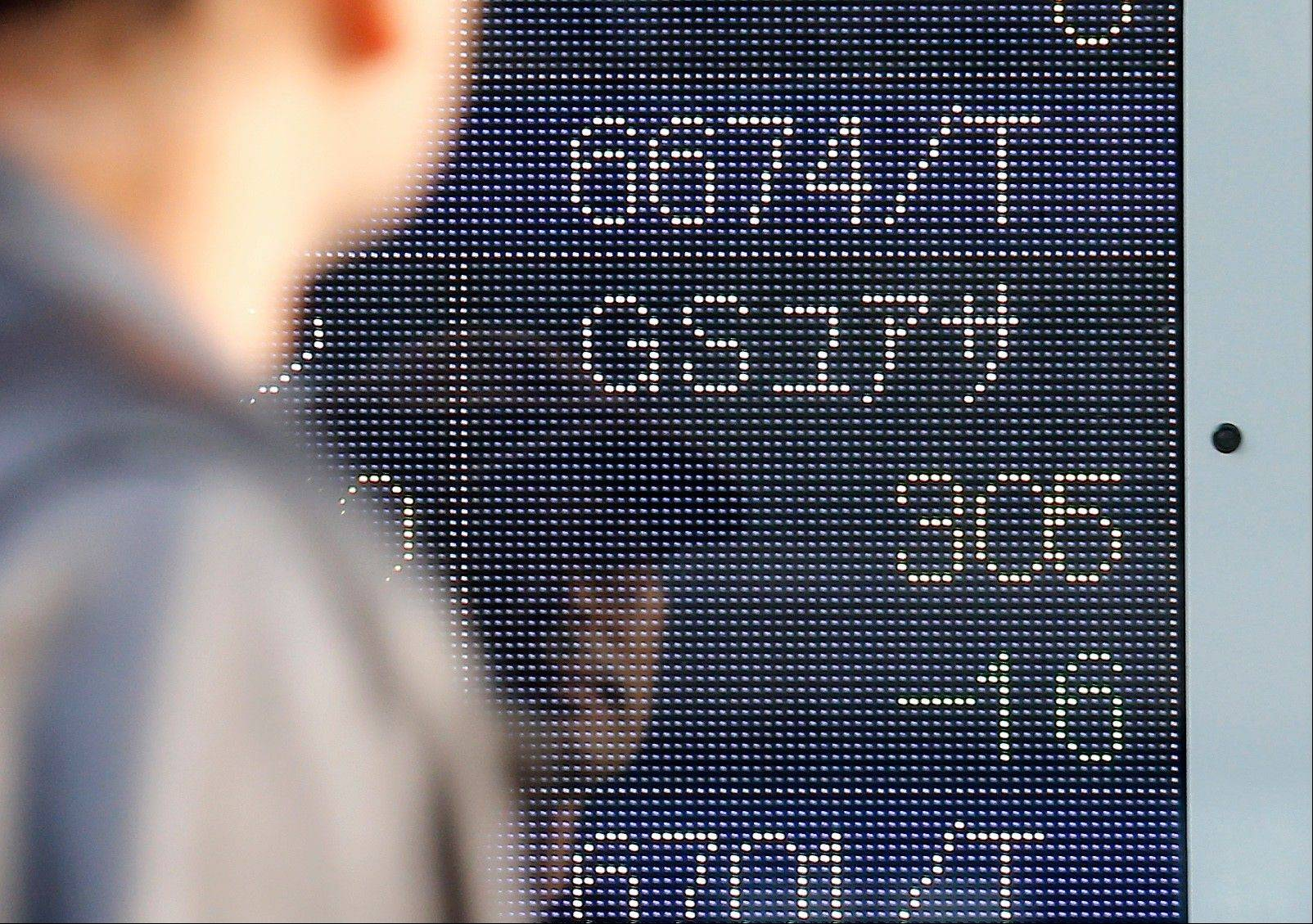 A man looks at the share price of Japanese manufacturer GS Yuasa that closed at 305 yen, 16 yen lower than the previous day trading, on the electronic stock board of a securities firm in Tokyo Thursday, Jan. 17, 2013. GS Yuasa is responsible for the battery of the Boeing's new 787 of which safety and reliability came into question again Wednesday when battery problems led to an emergency landing of an All Nippon Airlines, the biggest customers for the plane, temporarily grounded all 24 787s they own. Boeing shares fell more than 3 percent. (AP Photo/Koji Sasahara)