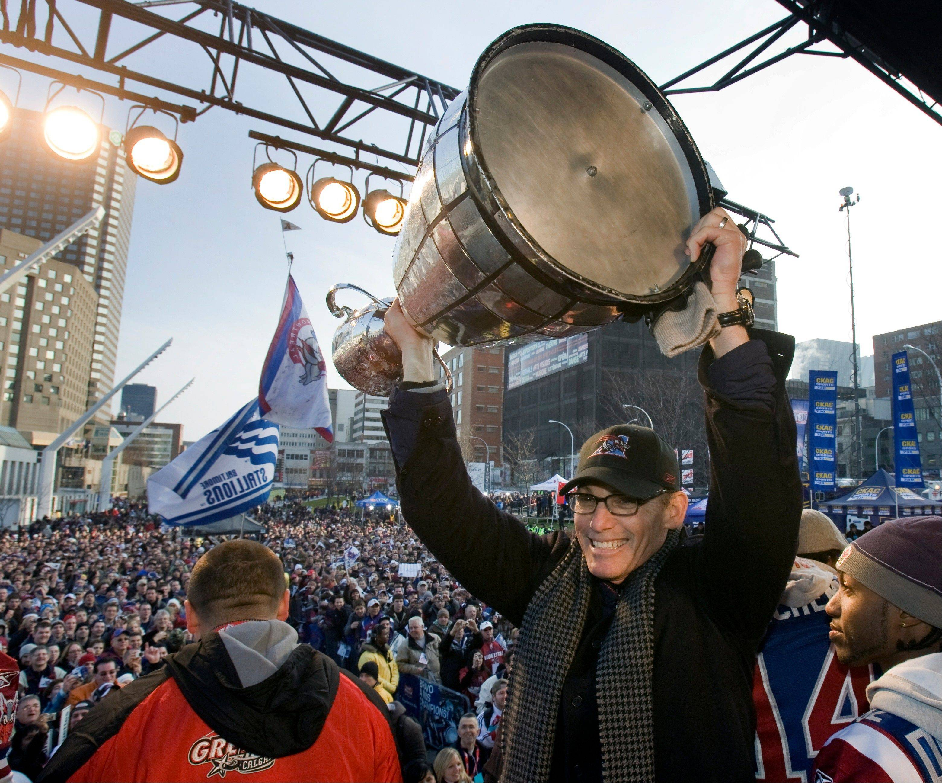 In this Dec. 2, 2009 file photo, Montreal Alouettes head coach Marc Trestman holds up the Grey Cup for fans during the victory parade in Montreal. The Bears have hired Trestman to replace the fired Lovie Smith, hoping he can get the most out of quarterback Jay Cutler and make Chicago a playoff team on a consistent basis. (AP Photo/The Canadian Press, Ryan Remiorz, File)