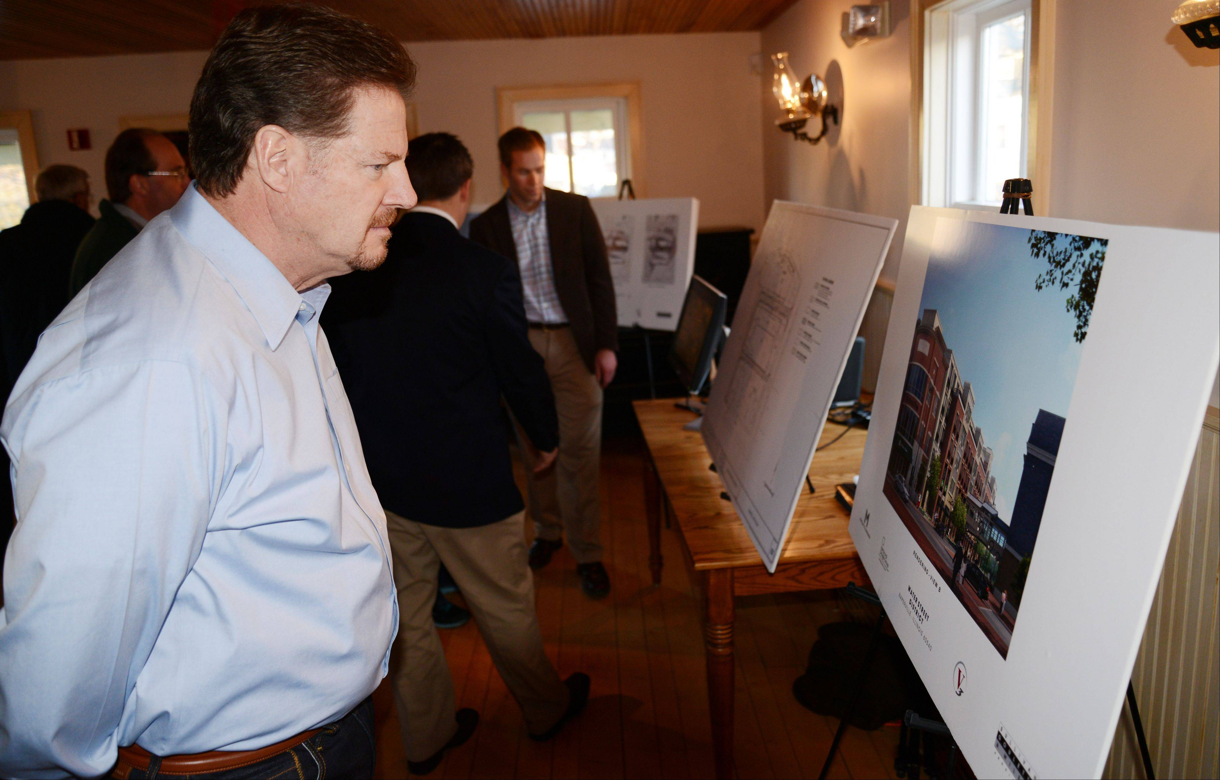 Bob Koch of Naperville was one of at least 120 people to attend during the first hour of an open house Thursday night featuring updated designs for the proposed Water Street development in downtown Naperville. Developer Marquette Cos. hosted the open house to gather public input before presenting the proposal to the city council Feb. 19.
