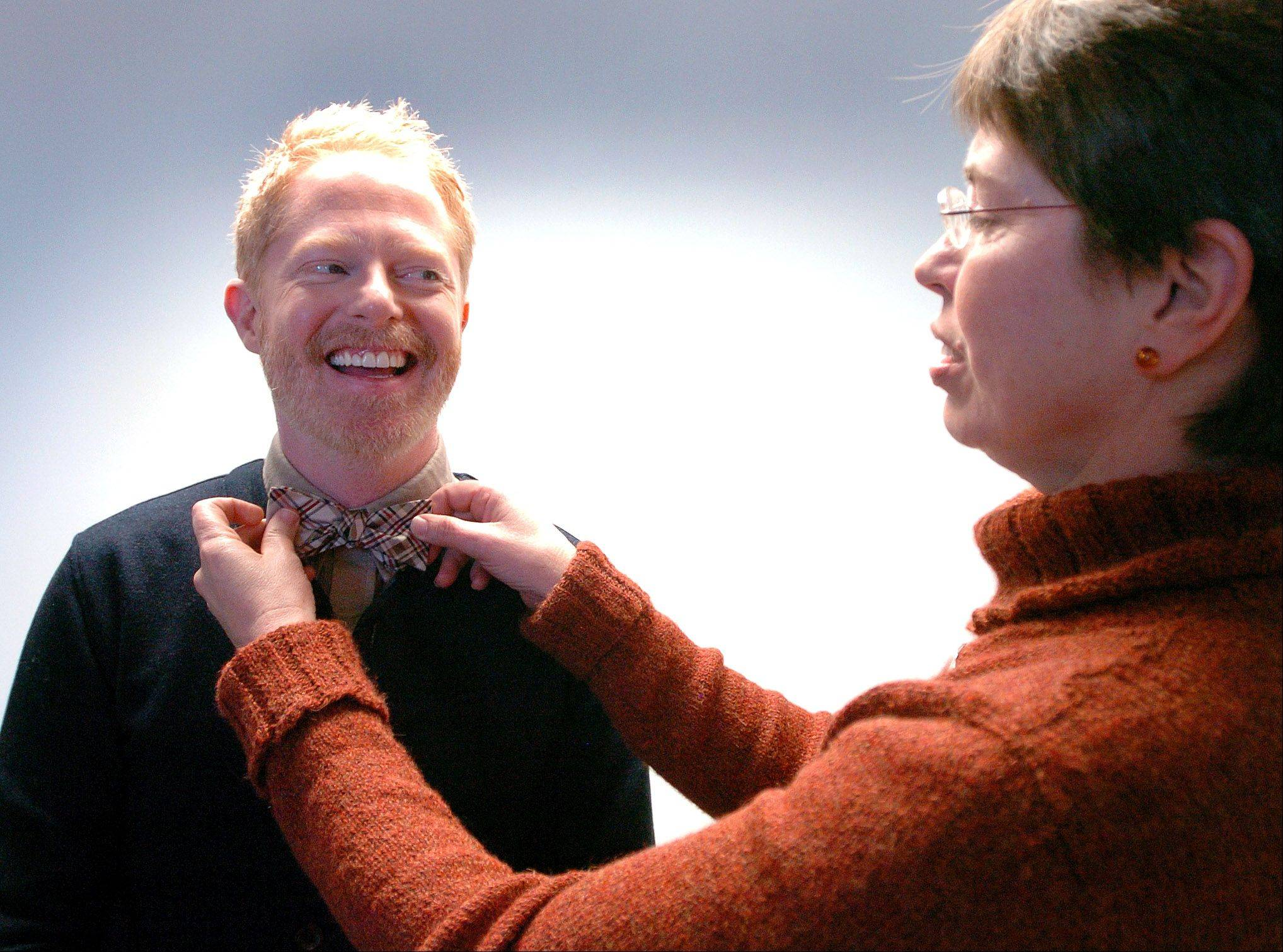 A bow tie always makes a fashion statement, but gay activist and actor Jesse Tyler Ferguson, getting a tie adjustment from Lt. Gov. Sheila Simon during a trip this month to Naperville, is making a political statement with his Tie The Knot campaign to support marriage equality.