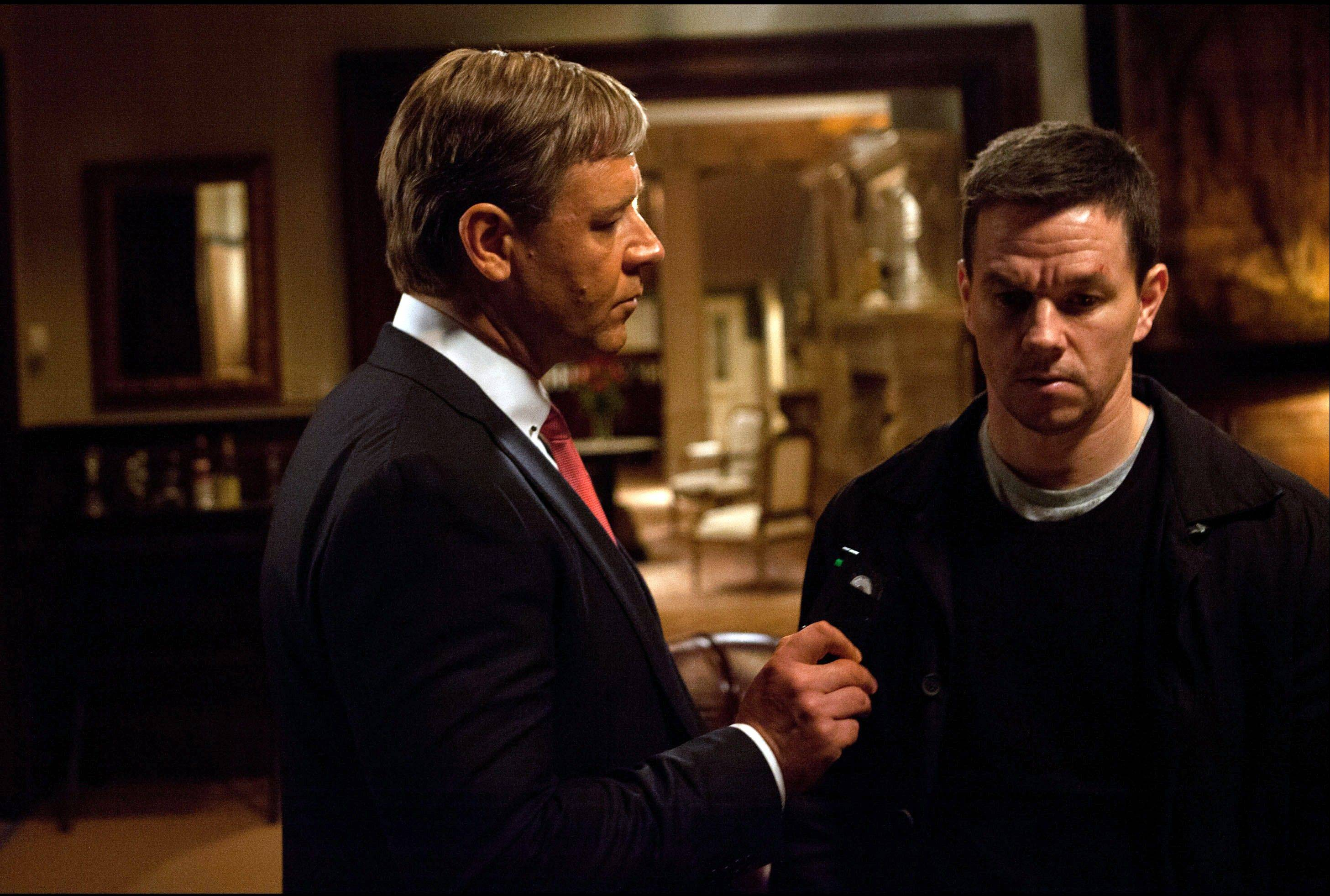 "New York City Mayor Nicholas Hostetler (Russell Crowe), left, hires a private eye with a shady past (Mark Wahlberg) in ""Broken City."""