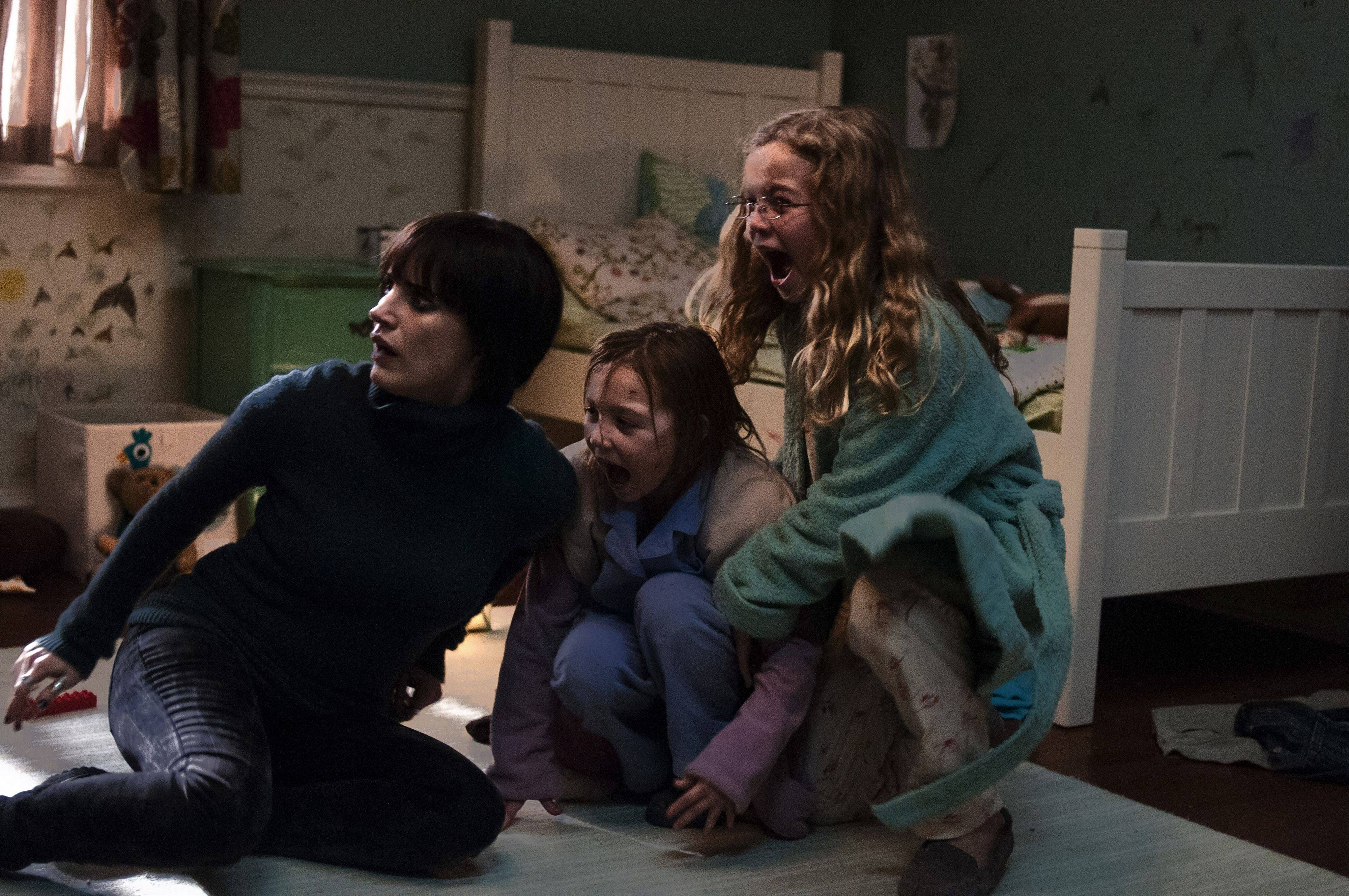"Annabel (Jessica Chastain) tries to protect Lilly (Isabelle N�lisse) and Victoria (Megan Charpentier) in ""Mama."""