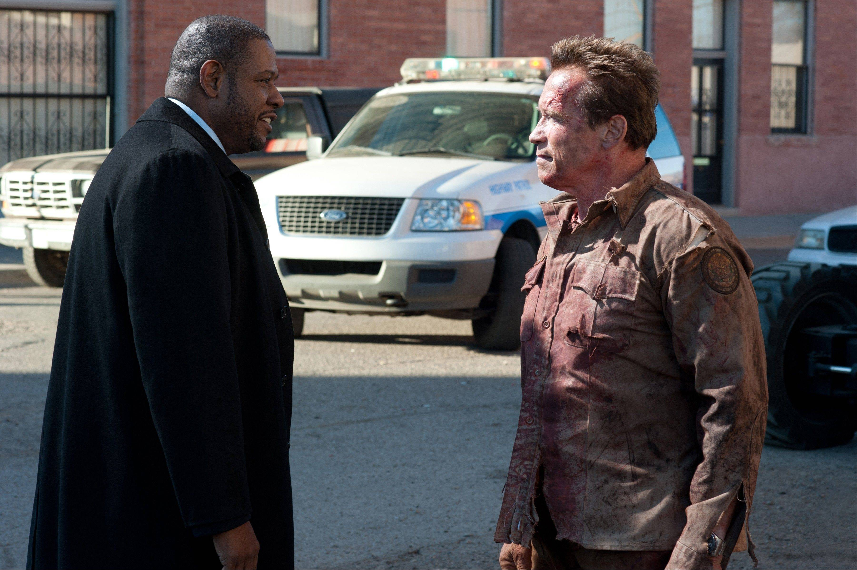 "An FBI agent (Forest Whitaker), left, pursues a drug kingpin to a border town protected by Sheriff Ray Owens (Arnold Schwarzenegger) in ""The Last Stand."""