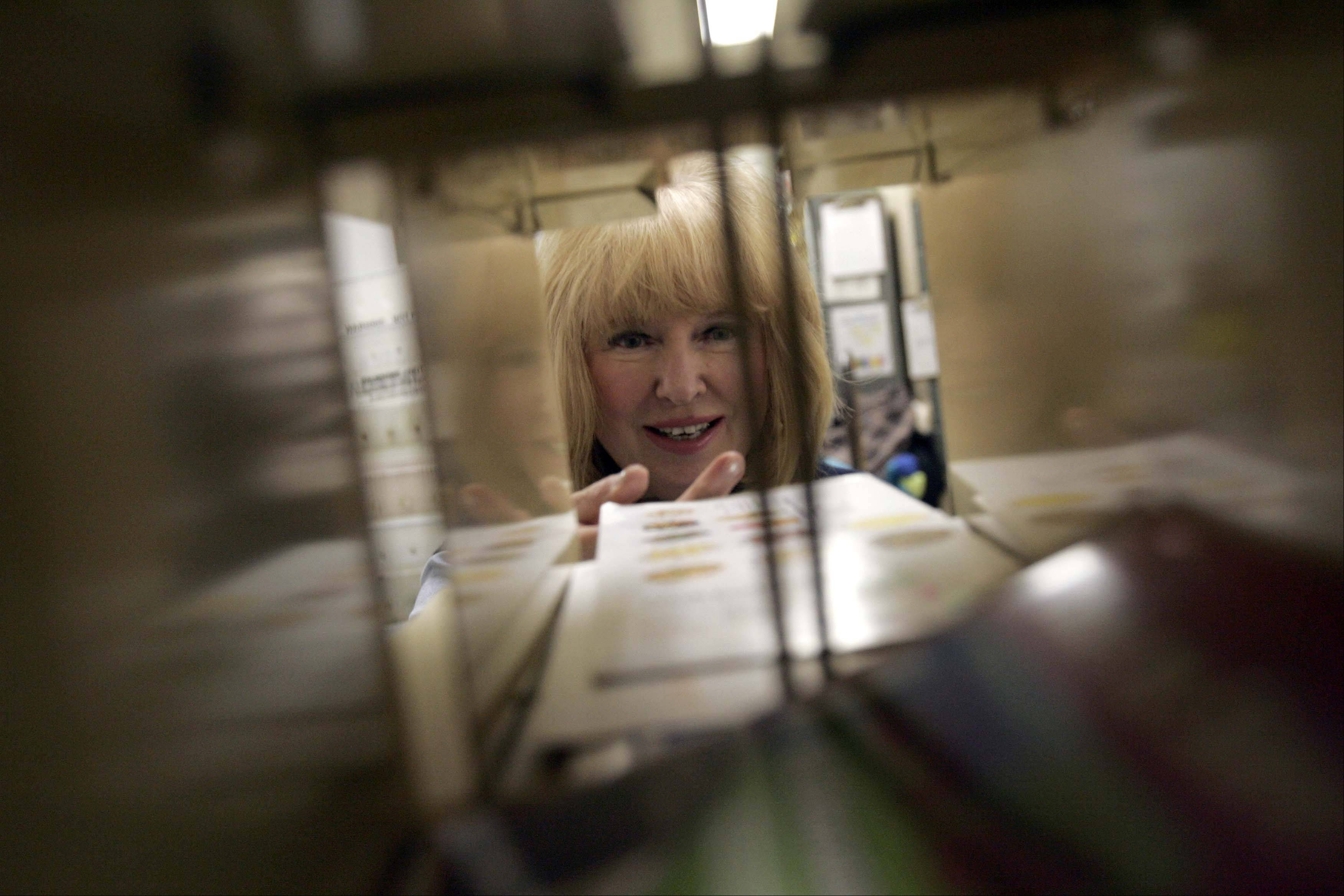 "Sue Teas has worked at the West Dundee post office since 1984. ""Through the years, I have made a lot close friends with the customers,"" Teas said."