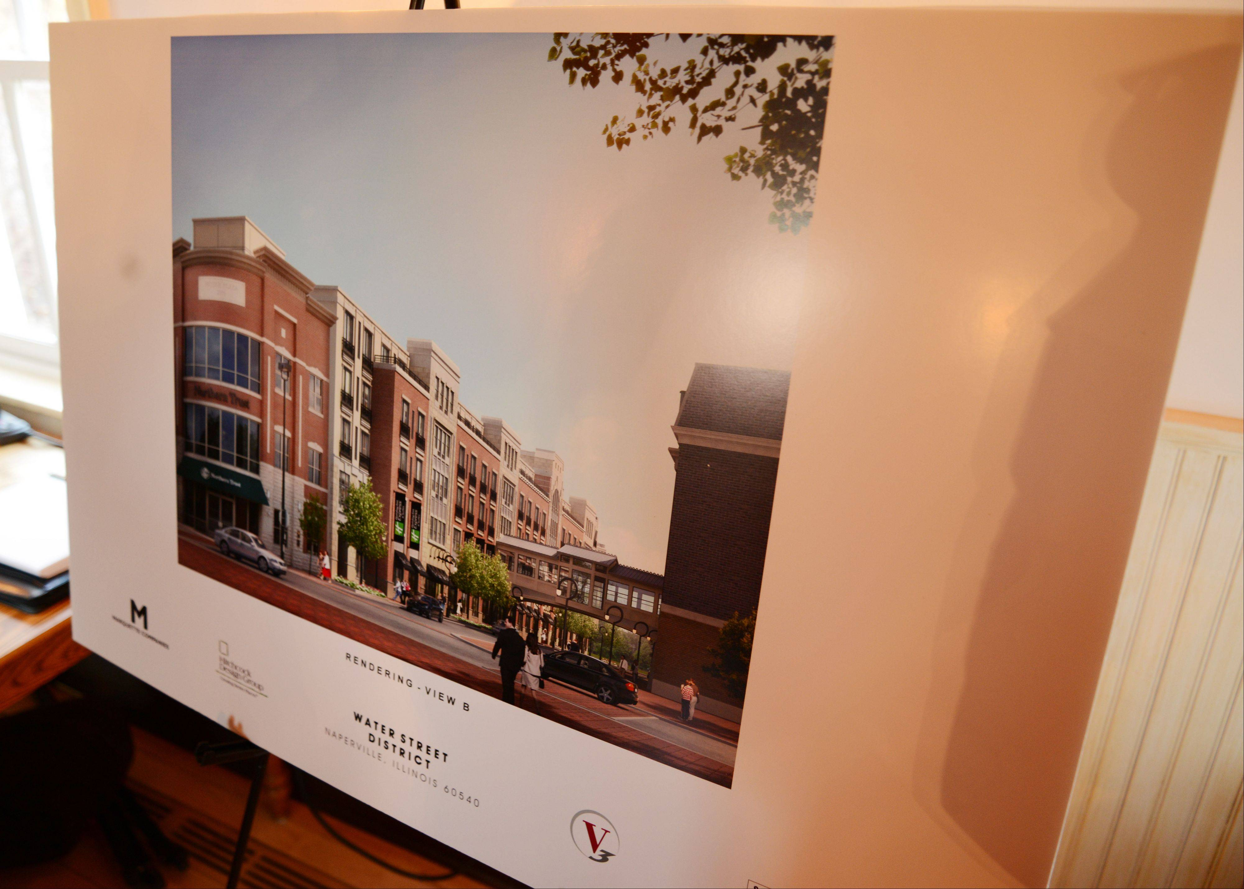 Renderings lined the perimeter of a room in the Naper Settlement's Pre-Emption House on Thursday night as Marquette Cos. presented the latest plans for the Water Street development in downtown Naperville.