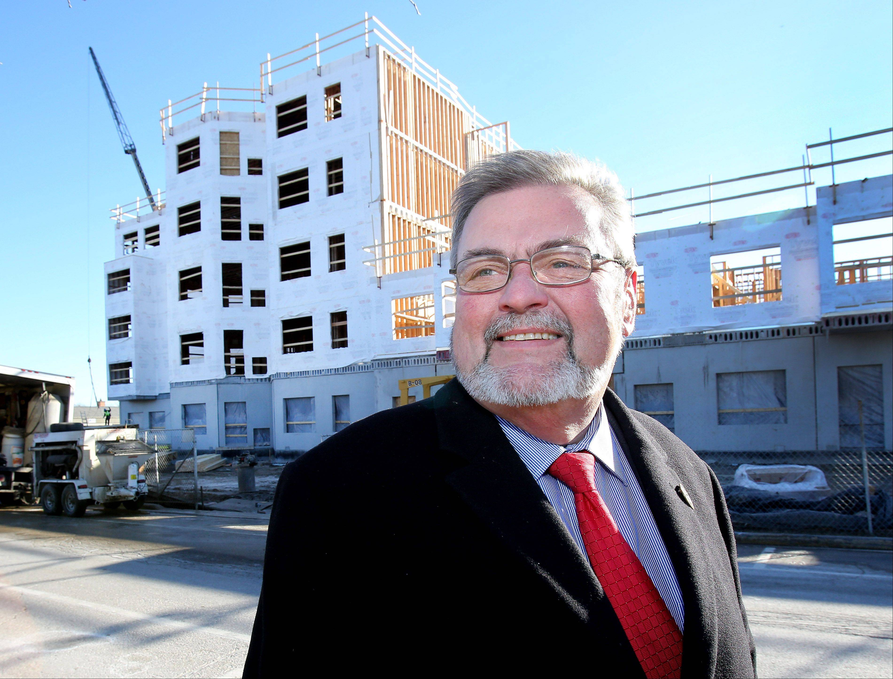 "Wheaton Mayor Michael Gresk says an upscale apartment complex under construction on Wesley Street demonstrates ""Wheaton is a very desirable place to live."""