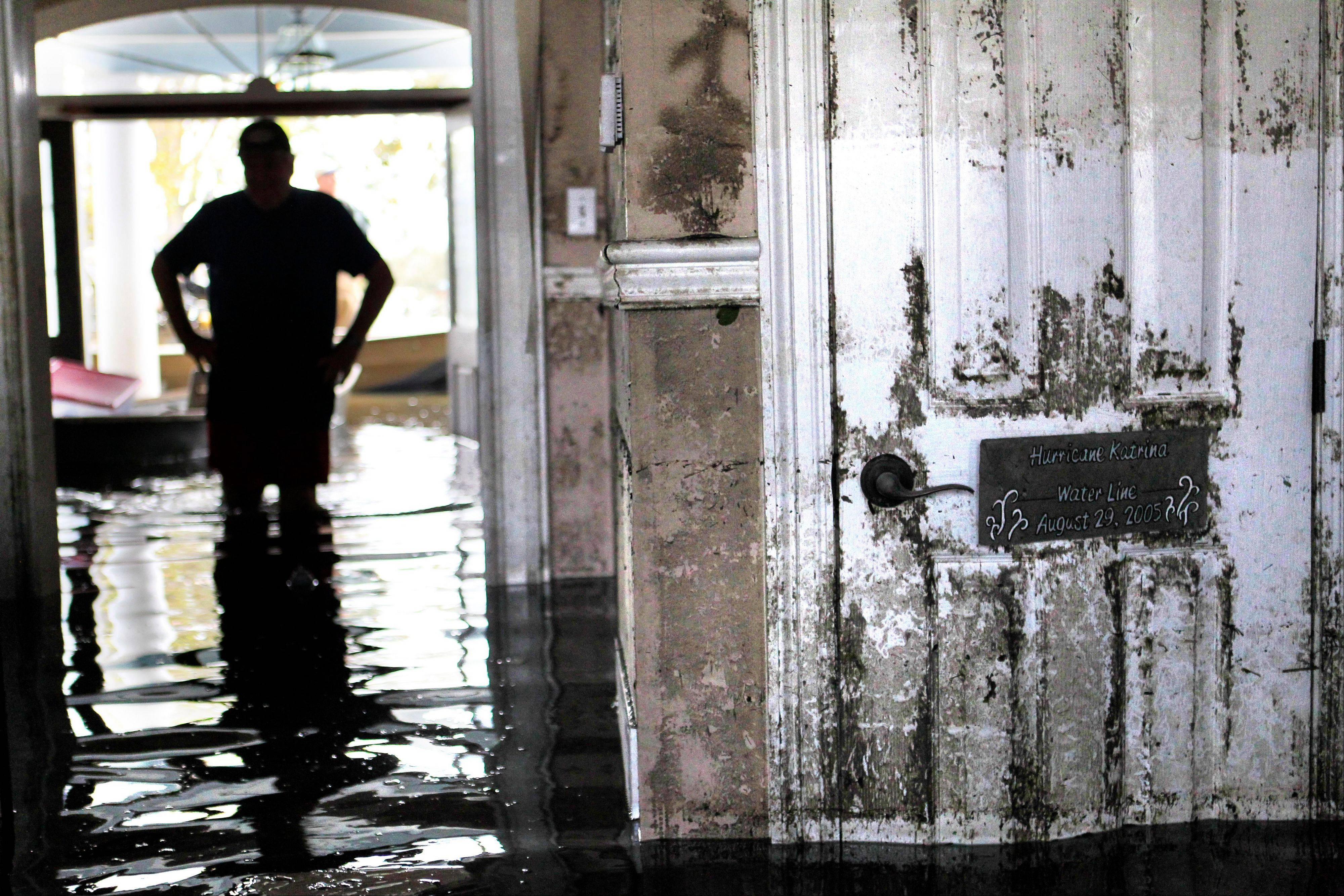 Don Duplantier walks through his flooded home as water recedes from Hurricane Isaac in Braithwaite, La., in September 2012.