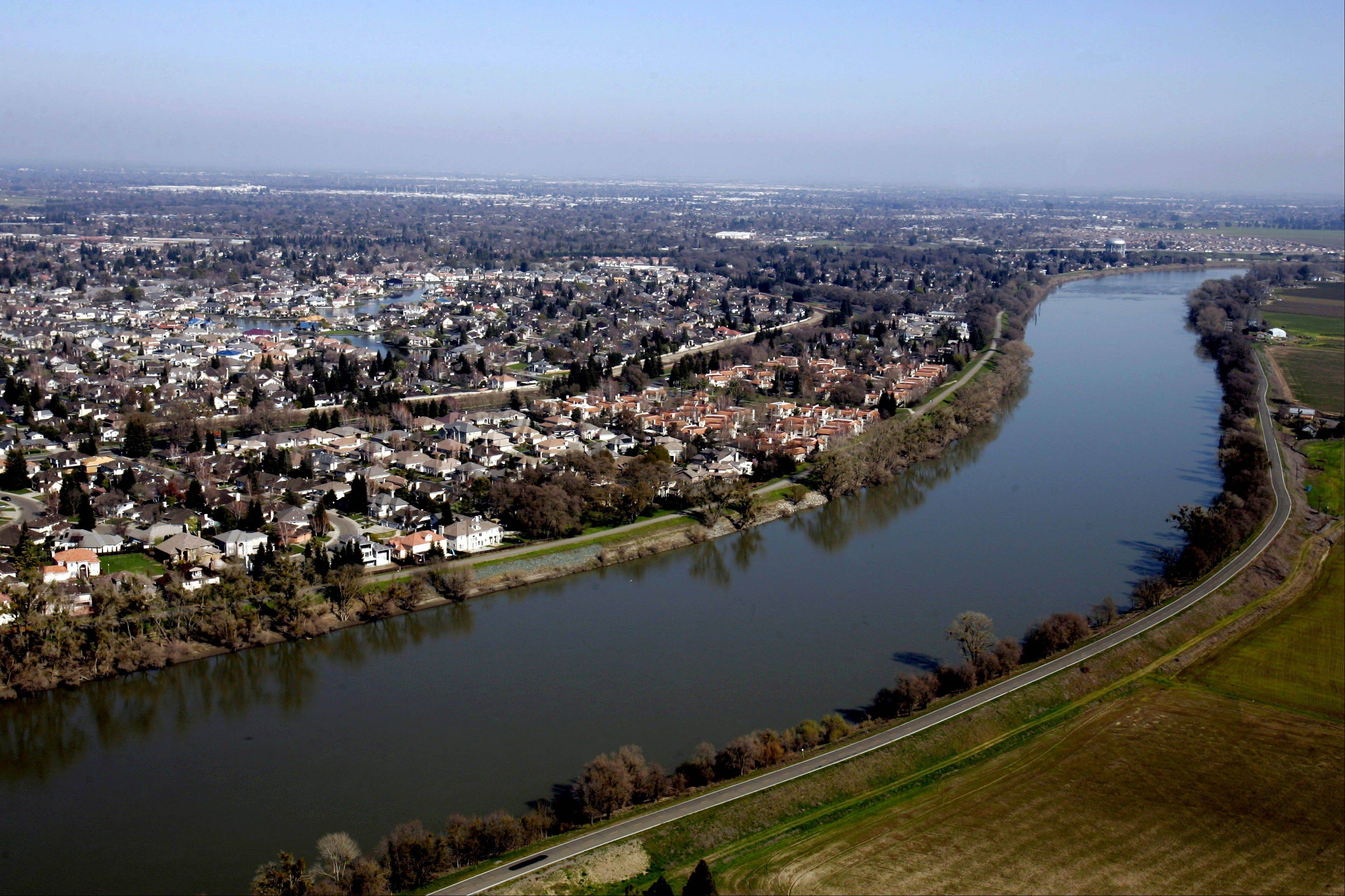 Houses located in the Pocket Area of Sacramento, Calif., along the Sacramento River. Aa 42-mile-long levee along the Sacramento and American rivers protects the Natomas area, a flood-prone basin transformed from cropland into a community of 100,000 with an airport, nearly three dozen schools and two interstates.