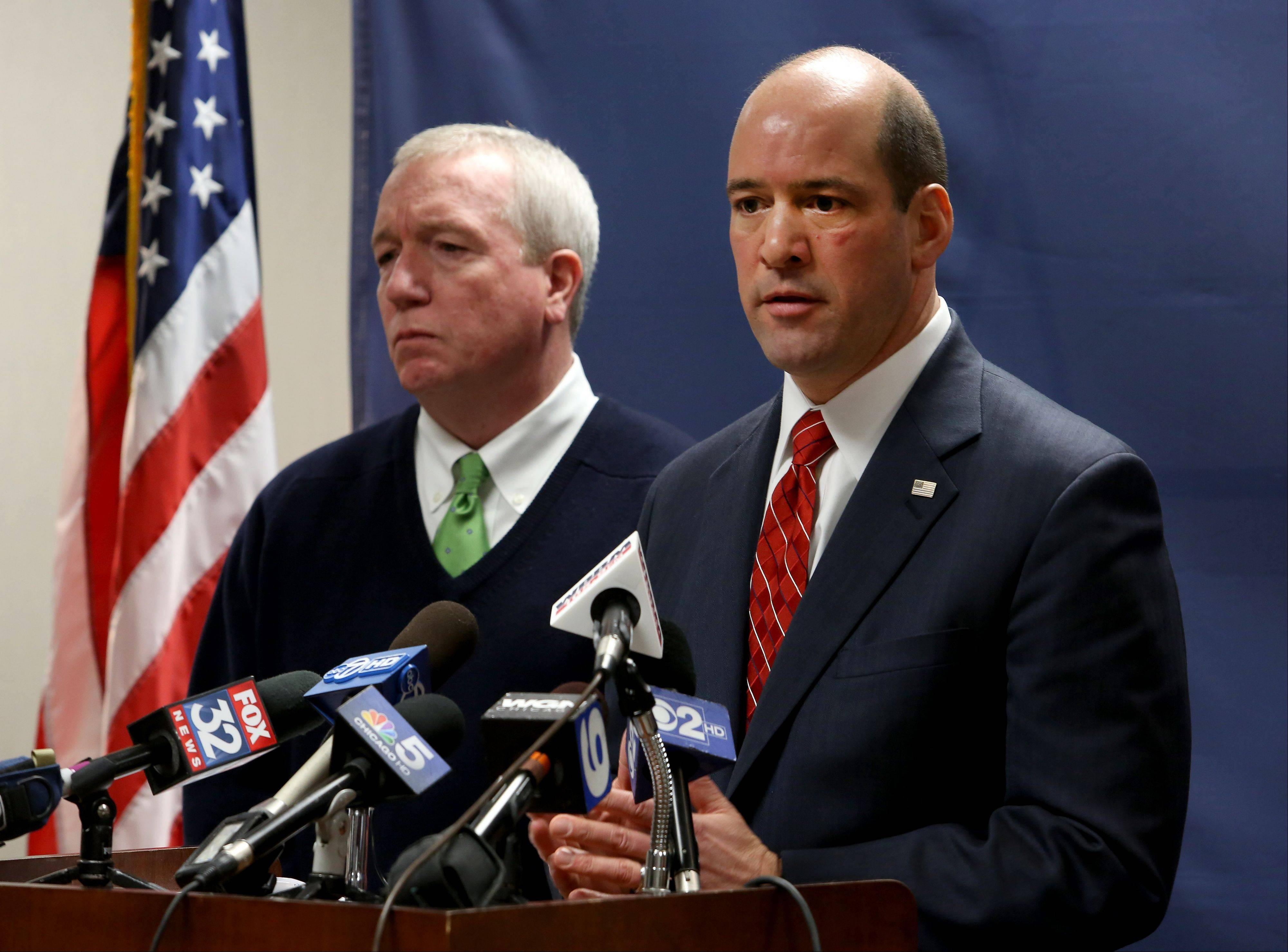 DuPage County State's Attorney Bob Berlin, right, with DEA Special Agent Jack Riley, announces criminal charges Thursday against three Schaumburg police officers accused of dealing drugs.