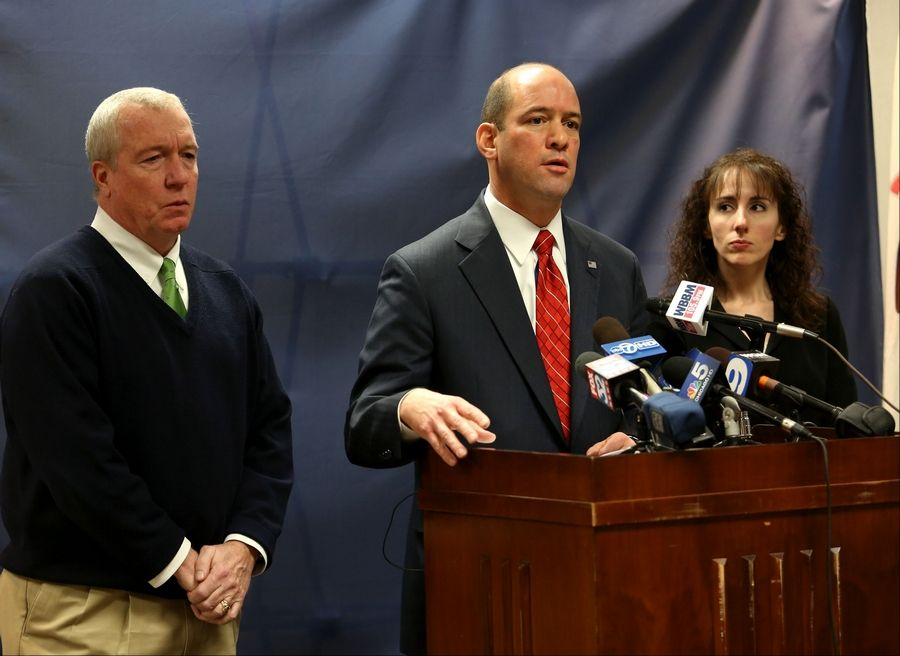 DuPage County State's Attorney Bob Berlin, center, with DEA Special Agent Jack Riley and Audrey Anderson, head of the narcotics division at the state's attorney's office, announce criminal charges against three Schaumburg police officers accused of dealing drugs.